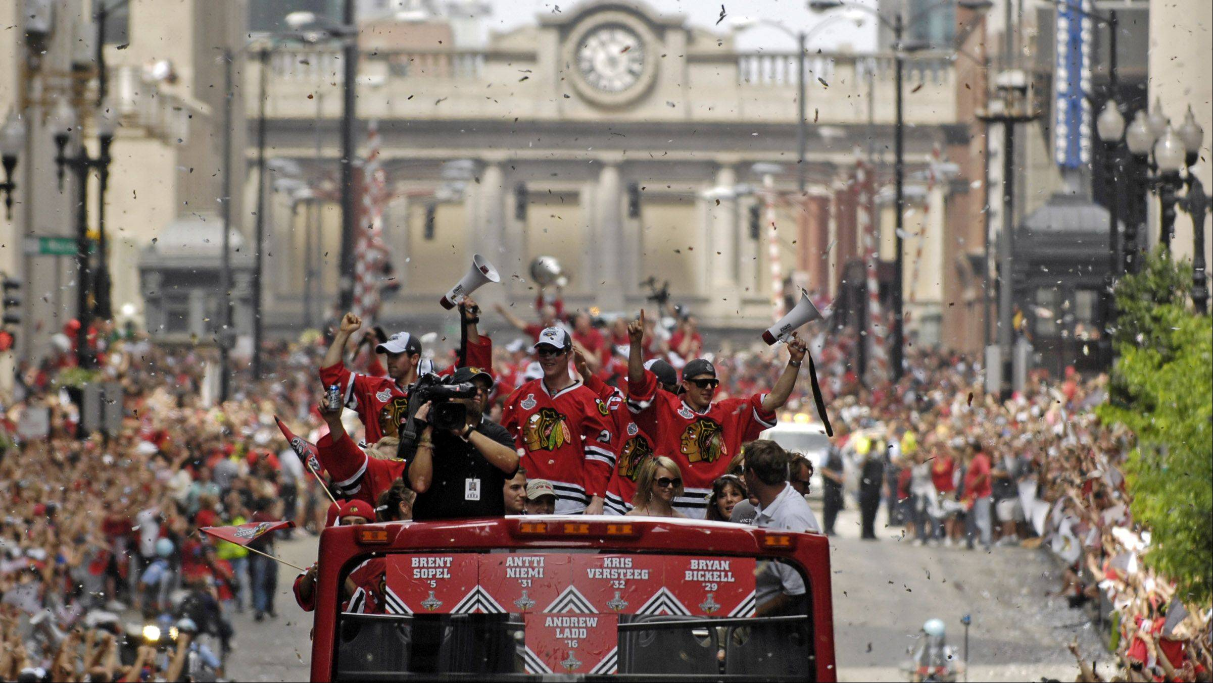 RICK WEST/rwest@dailyherald.com � The Hawks make their way along Washington during Friday's victory parade for the Chicago Blackhawks following their Stanley Cup Finals win over Philadelphia.