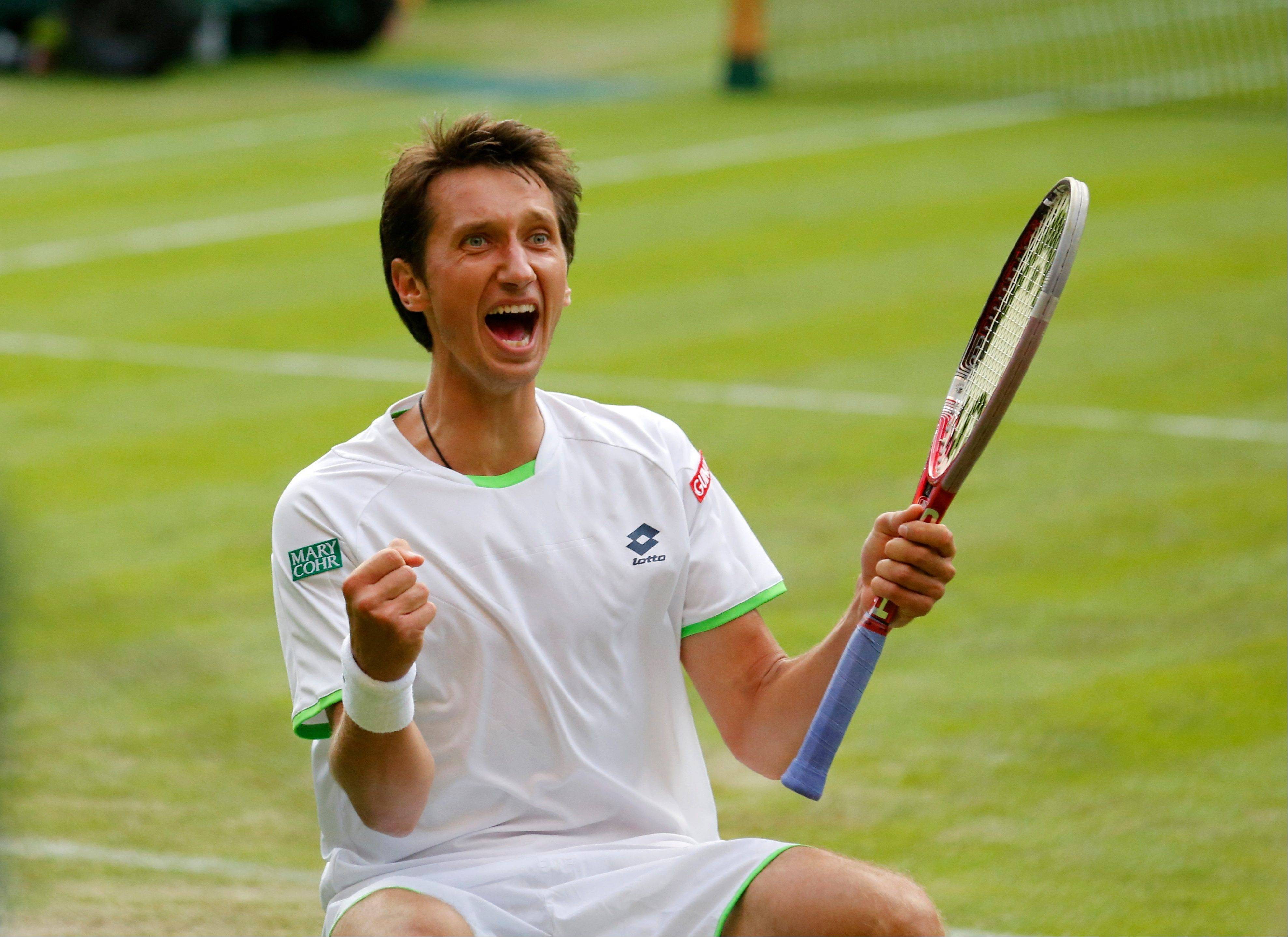 Sergiy Stakhovsky of Ukraine reacts as he wins against Roger Federer of Switzerland in their Men's second round singles match at the All England Lawn Tennis Championships in Wimbledon, London, Wednesday, June 26, 2013.