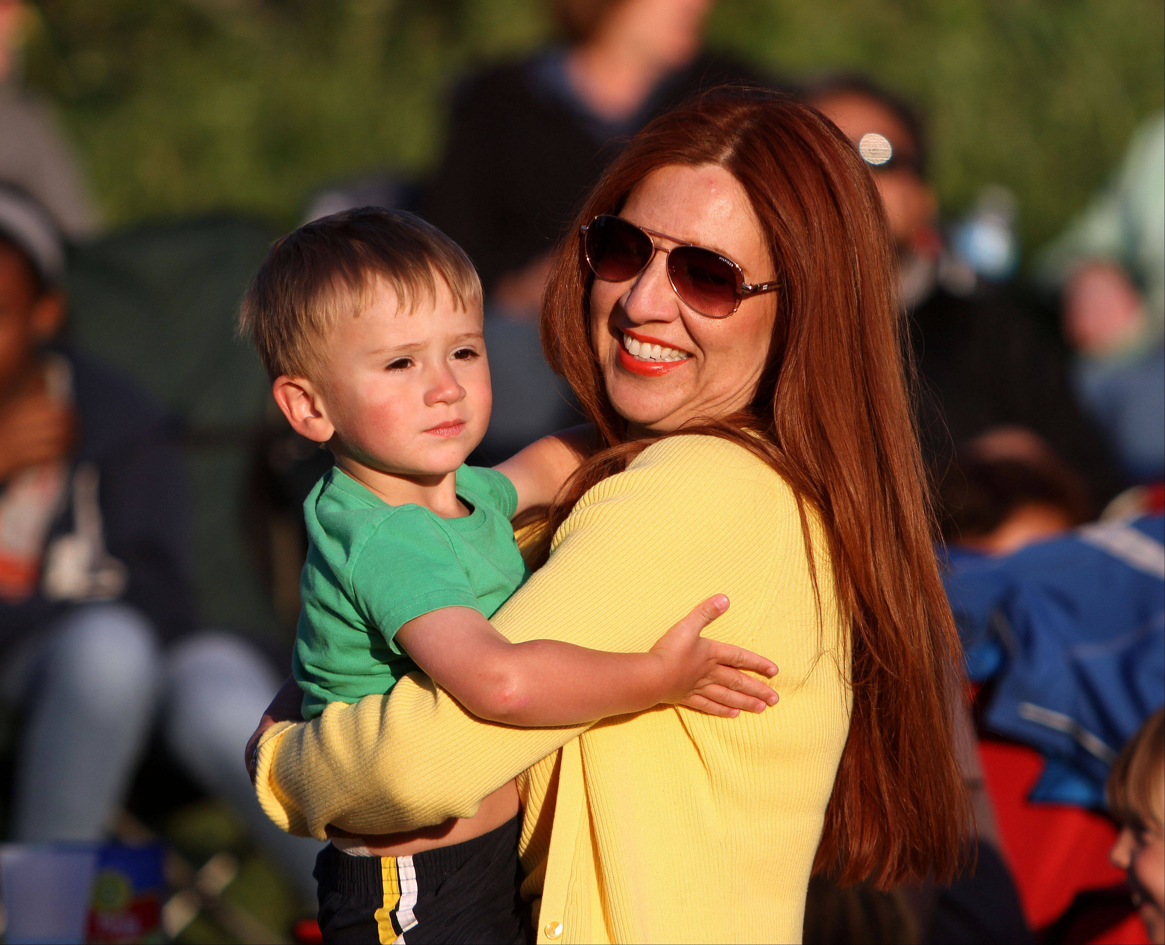 Annette Arnold dances with her 2-year-old nephew Brody Wozniak, both of Round Lake, as Events in the Plaza outdoor summer concert series kicked off Tuesday night with a performance by Chicago R&B Kings at Independence Grove Forest Preserve in Libertyville.