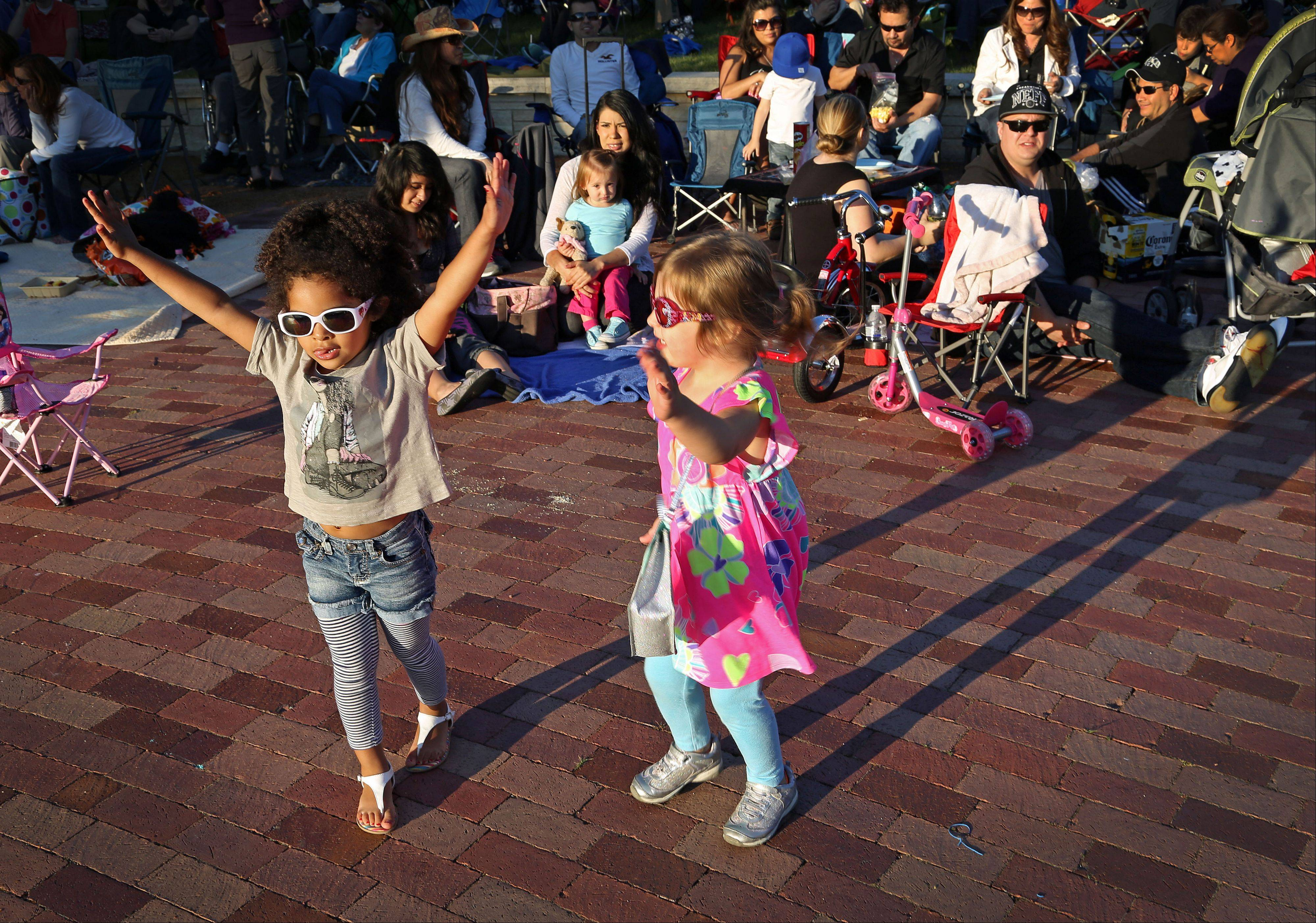 3-year-old Bella Stapleton, left, and 3-year-old Bella Davies of Gurnee dance to the sounds of Chicago R&B Kings during Events in the Plaza outdoor summer concert series Tuesday night at Independence Grove Forest Preserve in Libertyville.