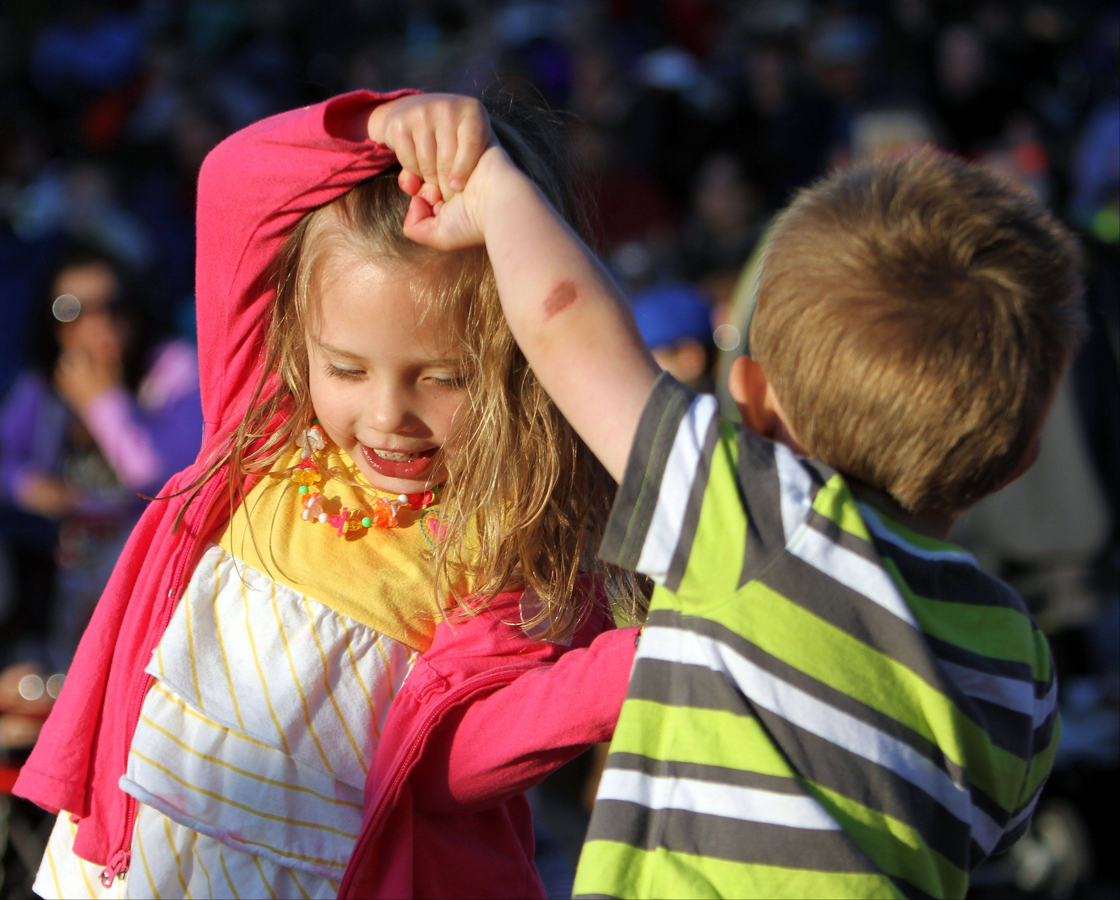 Ella Evans, 3, and her brother, Charlie, 2, of Green Oaks dance to the sounds of Chicago R&B Kings during Events in the Plaza outdoor summer concert series Tuesday night at Independence Grove Forest Preserve in Libertyville.