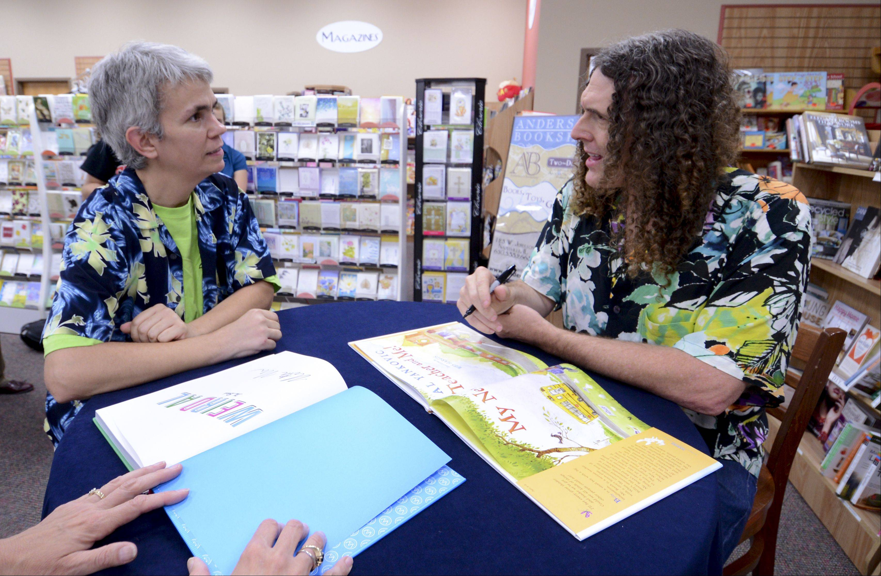 Longtime fan Fred Olderr of Melrose Park chats with Weird Al Yankovic on Wednesday during a book signing for his new book �My New Teacher and Me� at Anderson�s Bookshop in Naperville.