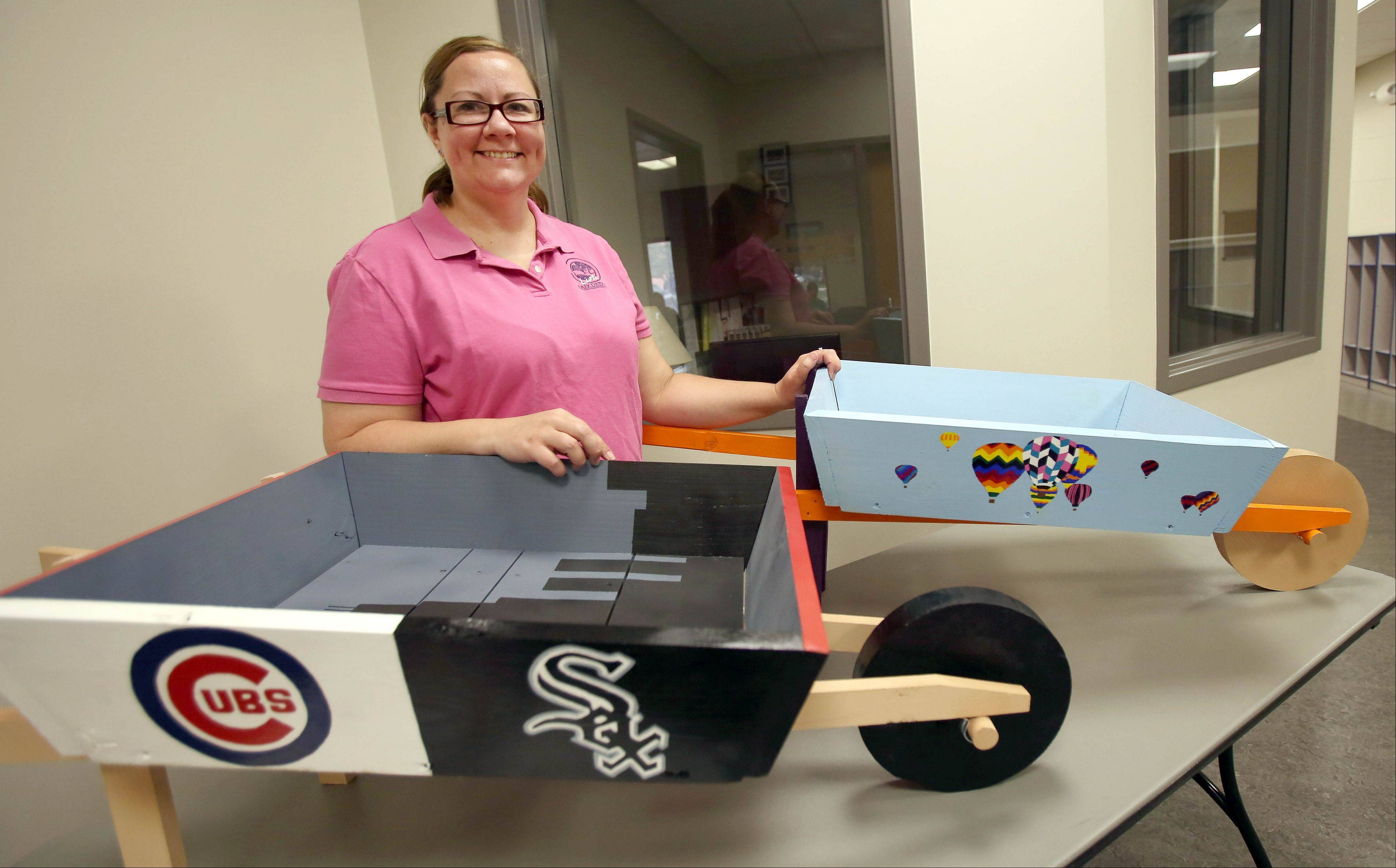 Lisle Park District event coordinator Wendy Nadeau is the driving force behind a public art project this year that features decorated wooden wheelbarrows.