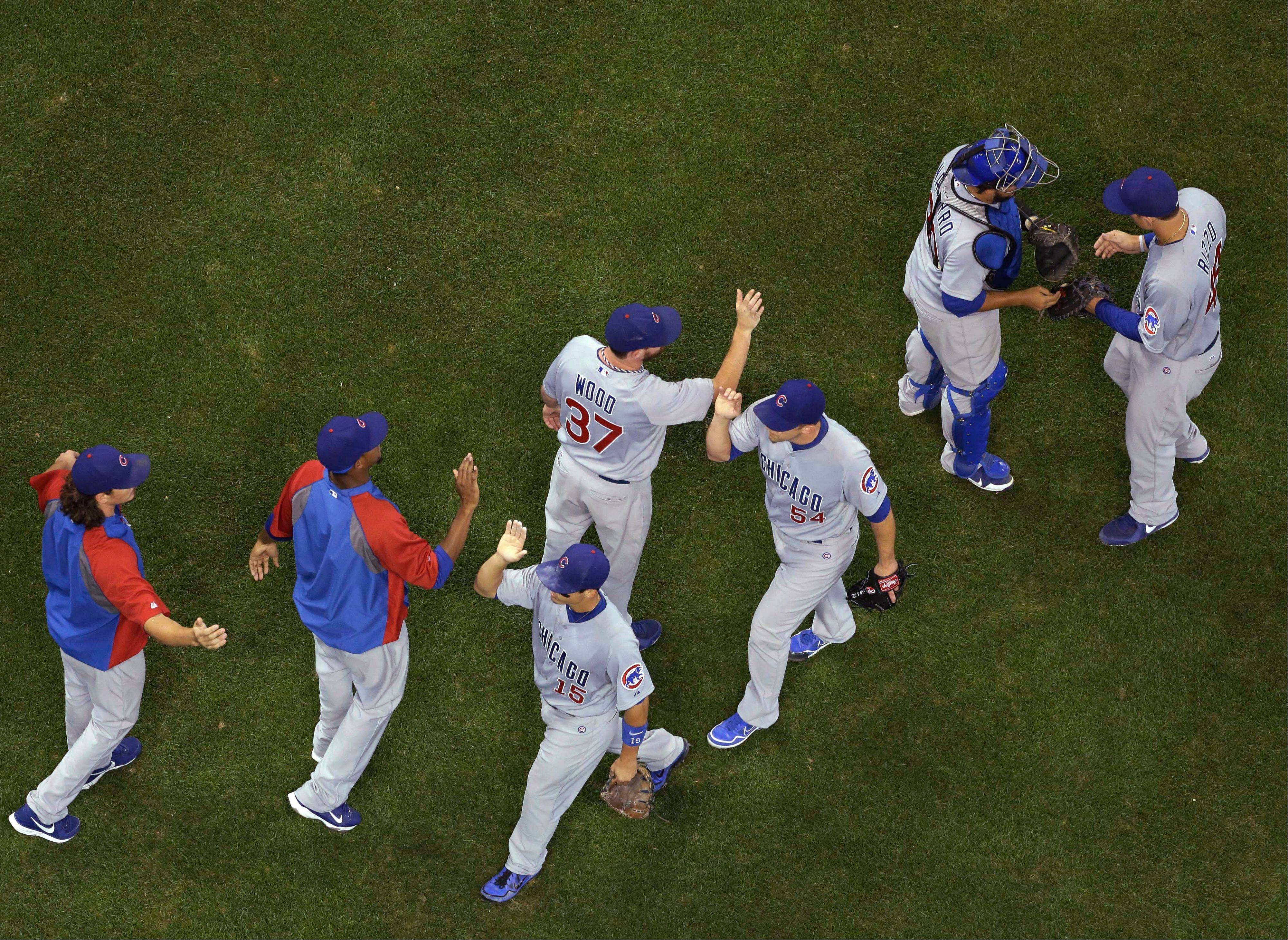 The Cubs celebrate their 7-2 win over Milwaukee Brewers in a baseball game Thursday, June 27, 2013, in Milwaukee.