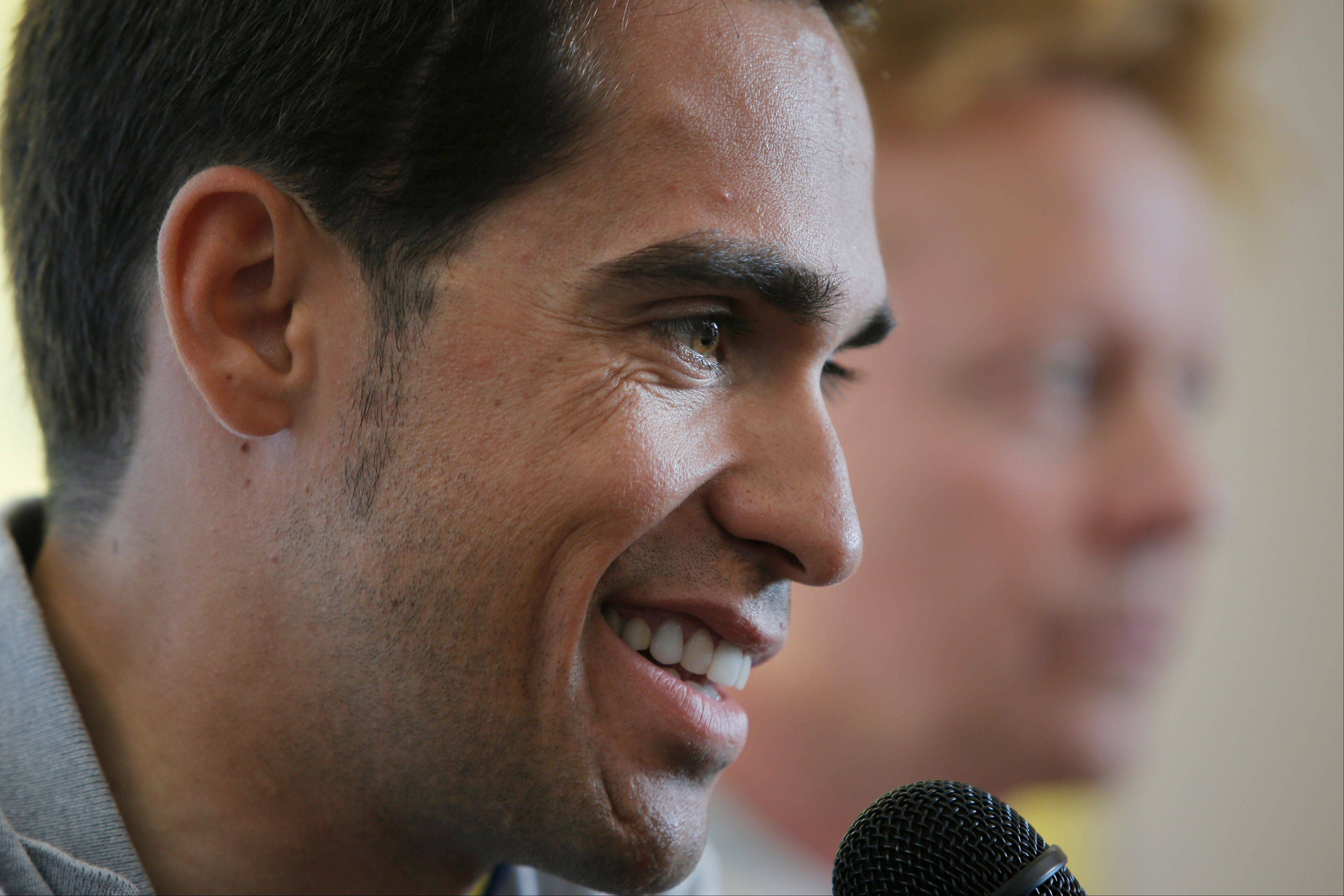 Cyclist Alberto Contador answers questions of reporters during a news conference Thursday. The Tour de France starts in Porto Vecchio on Saturday.