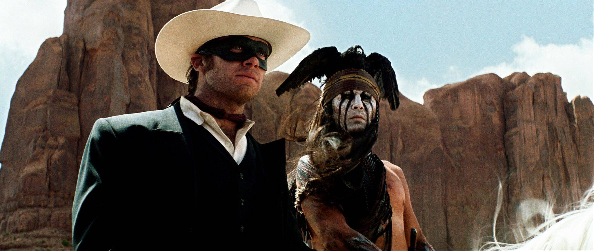 "Armie Hammer, left, as The Lone Ranger, and Johnny Depp, as Tonto, in a scene from the film, ""The Lone Ranger,"" which releases July 3."