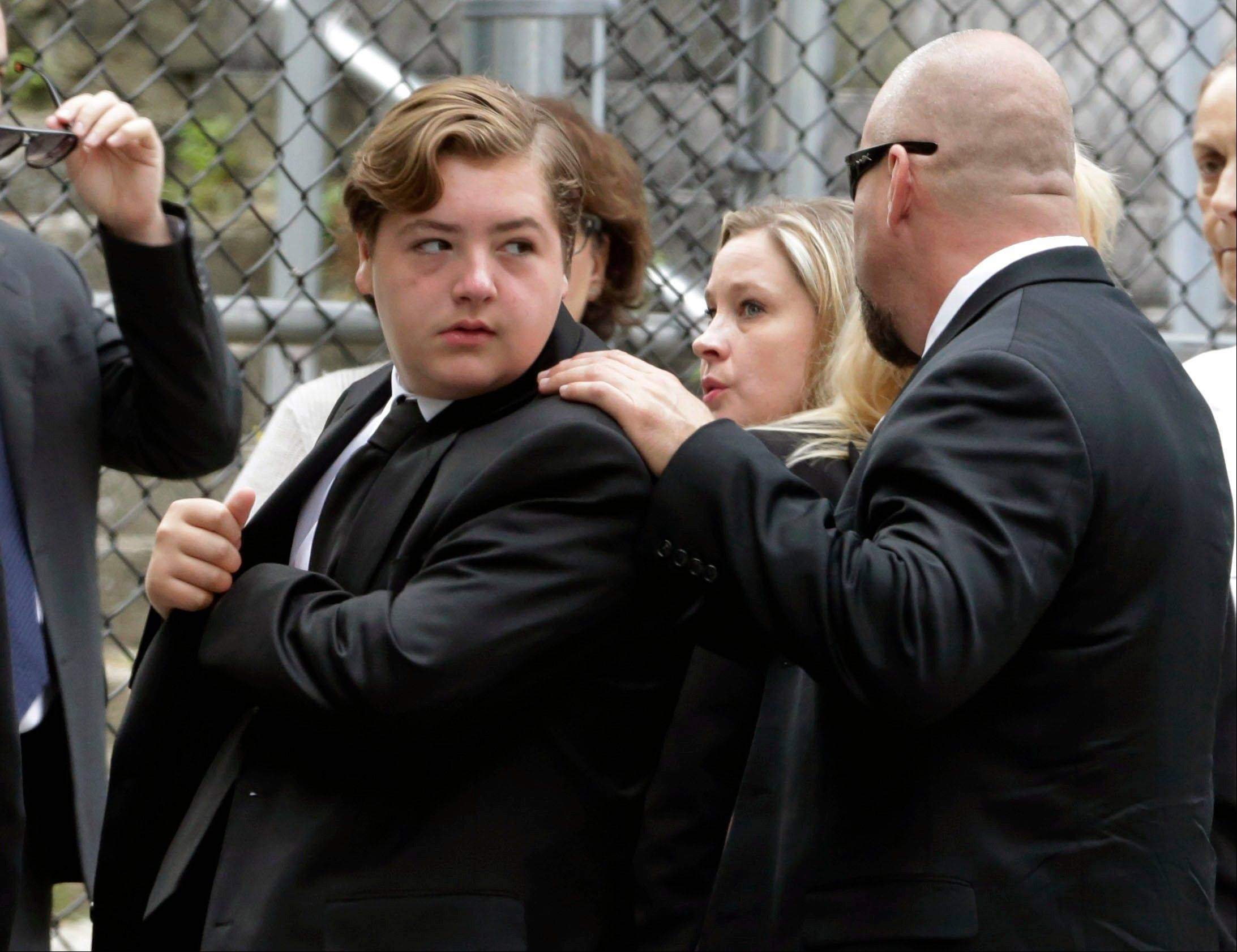 "Michael Gandolfini, left, son of James Gandolfini, arrives for the funeral service of his father, star of ""The Sopranos,"" in New York's the Cathedral Church of Saint John the Divine, Thursday, June 27, 2013. The 51-year-old actor died of a heart attack last week while vacationing in Italy with his son."