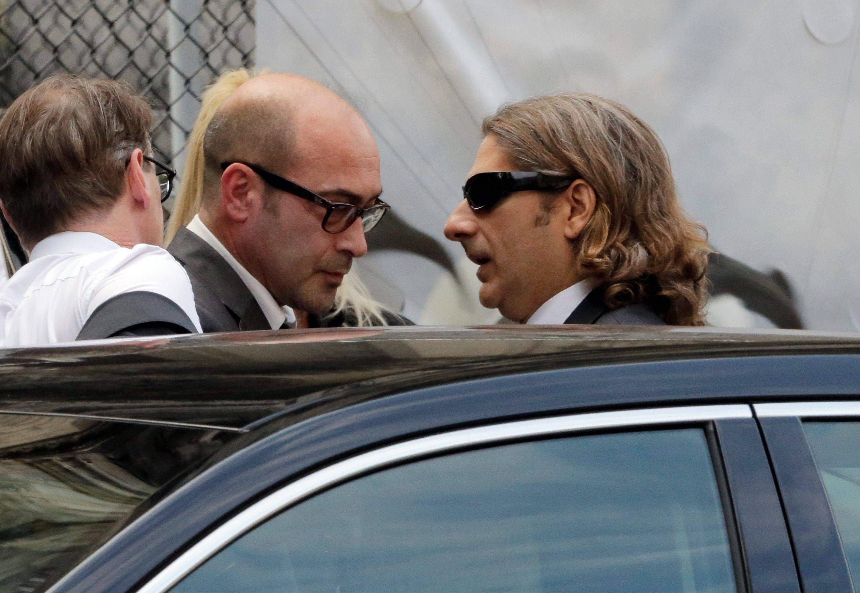 Actors John Ventimiglia, left, and Michael Imperioli arrive for the funeral service of James Gandolfini.