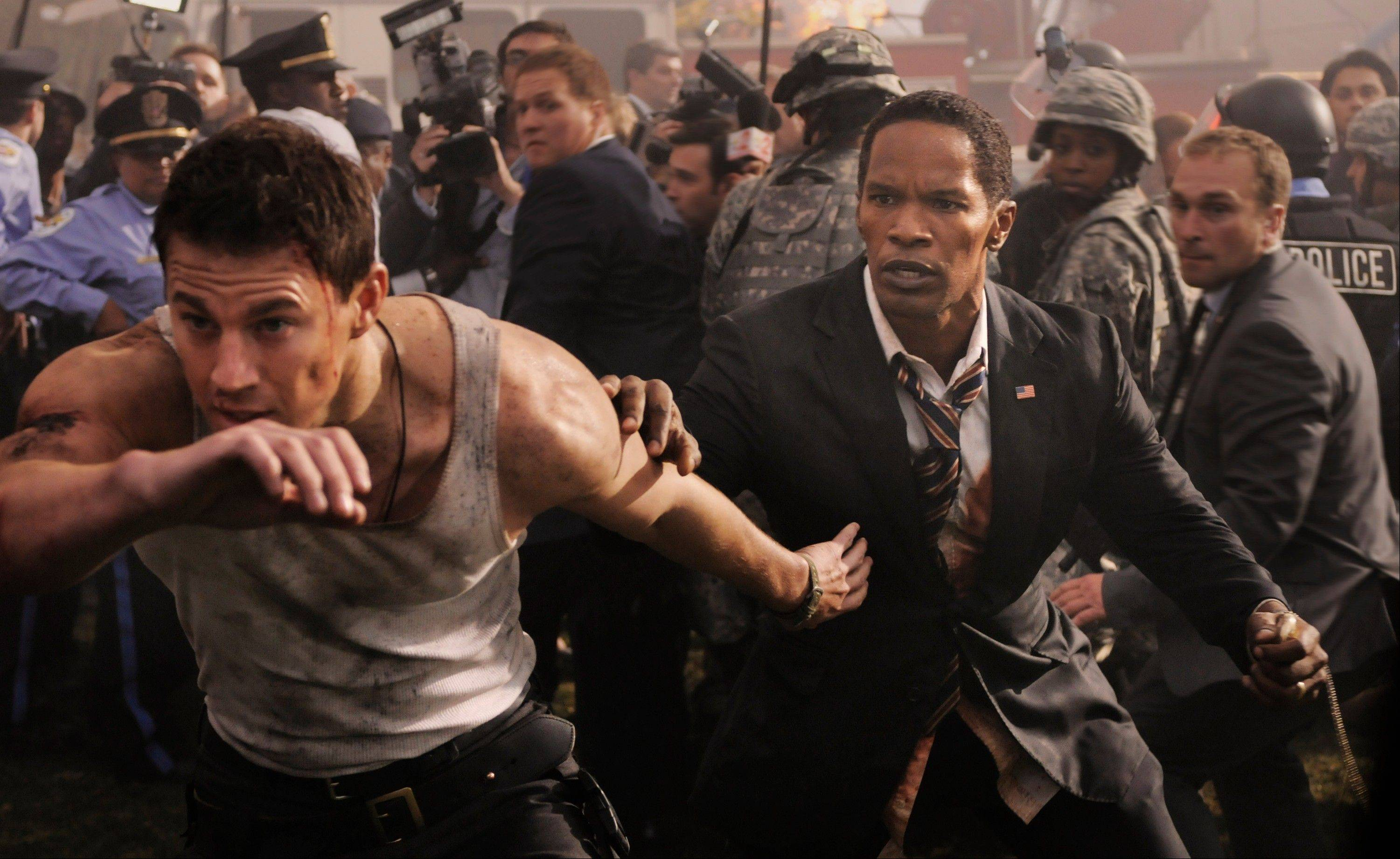 "U.S. President Sawyer (Jamie Foxx) gets help from a buff cop (Channing Tatum) when terrorists hit the Capitol in the inadvertently comical ""White House Down."""