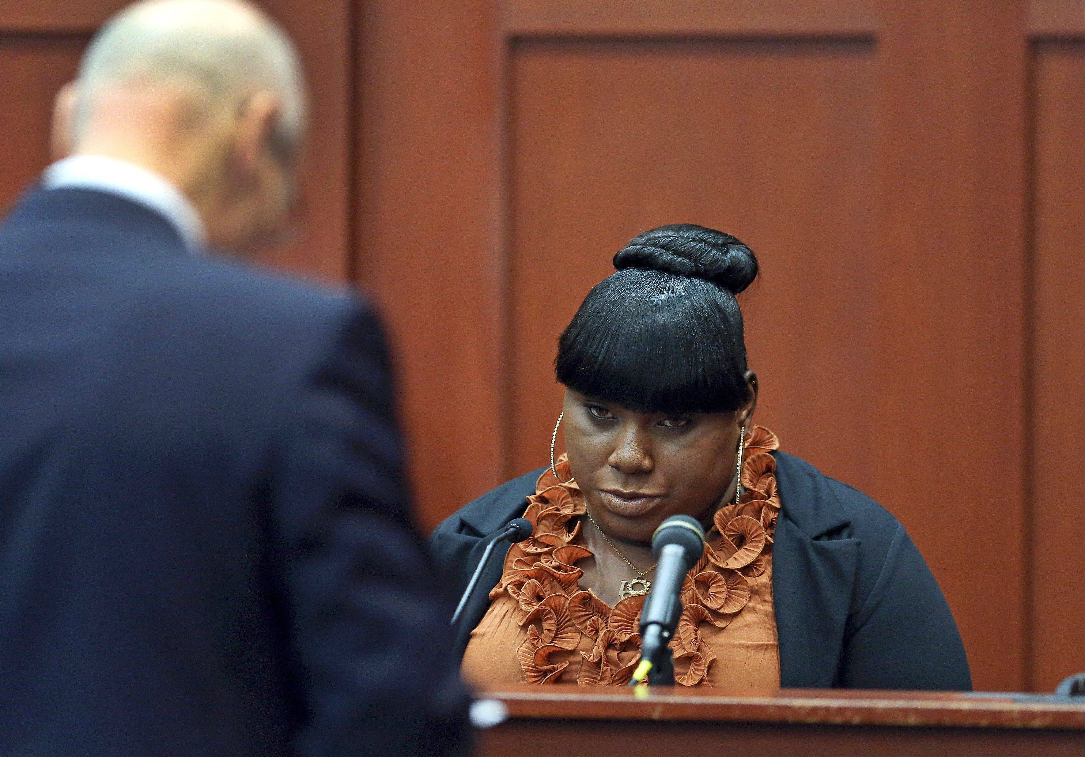 Witness Rachel Jeantel, right, continues her testimony to defense attorney Don West in George Zimmerman's trial in Seminole circuit court in Sanford, Fla. Thursday, June 27, 2013. Zimmerman has been charged with second-degree murder for the 2012 shooting death of Trayvon Martin.