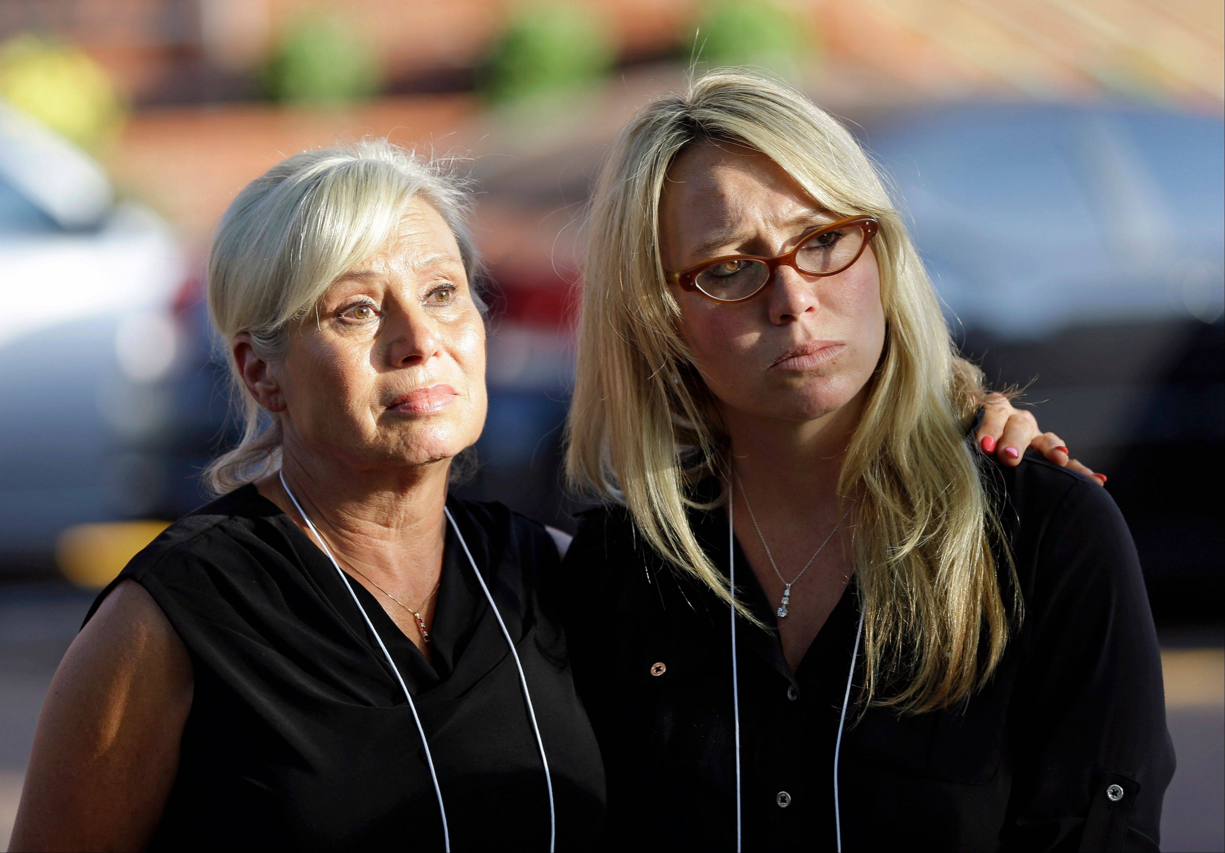 Donna Aldred, left, and her daughter, Leslie Lambert, right, listen during a news conference after the execution of Kimberly McCarthy at the Texas Department of Criminal Justice Huntsville Unit. Aldred's mother, Dorothy Booth, was killed by Kimberly McCarthy in 1997. McCarthy is the 500th person executed in Texas since 1982.