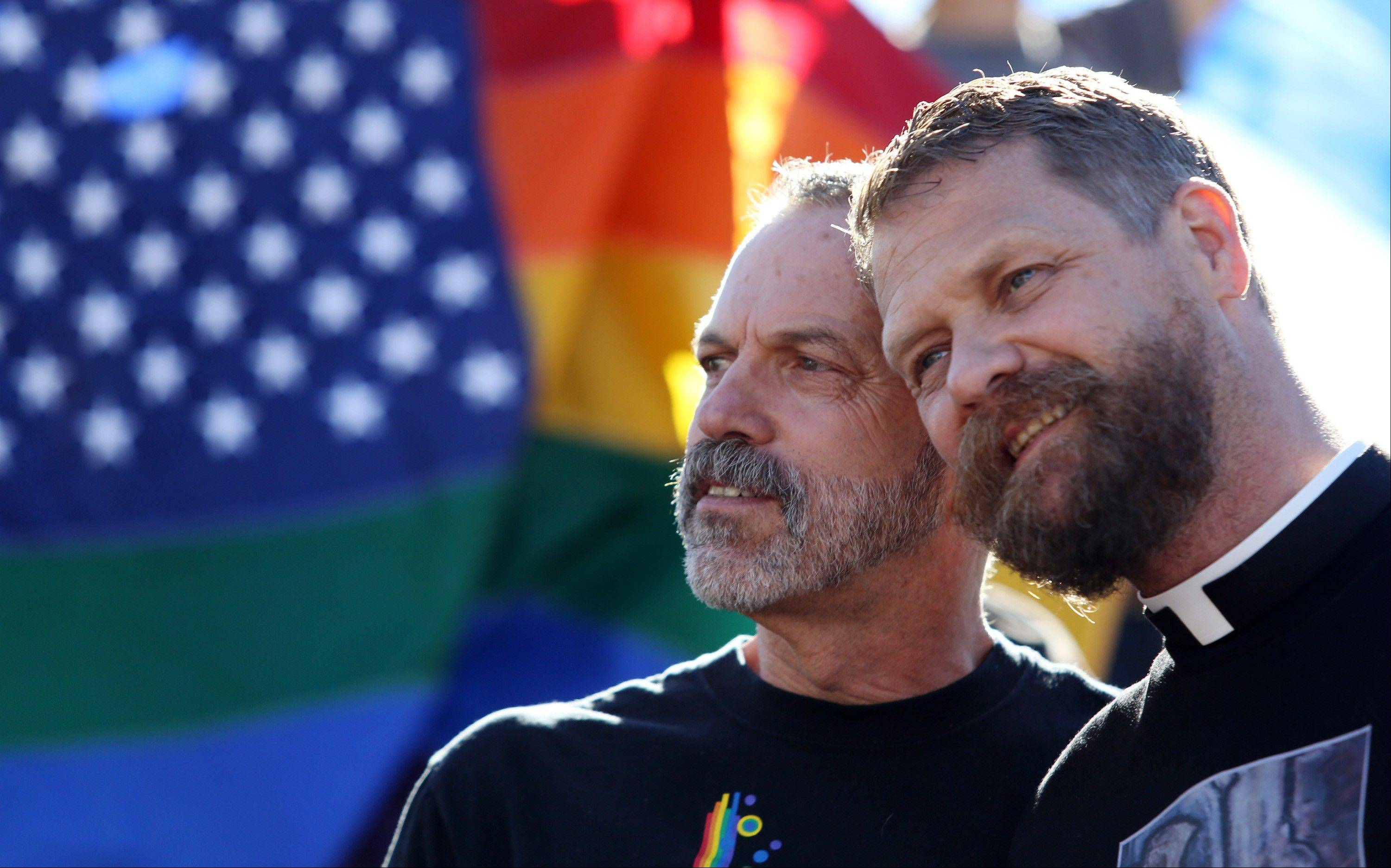 Associated Press Michael Deschenes, left, and Cary Bass, who had church wedding and plan to become legally married, stand together at a celebration for the U. S. Supreme Court's rulings on Prop. 8 and DOMA in the Castro District in San Francisco, on Wednesday, June 26, 2013.