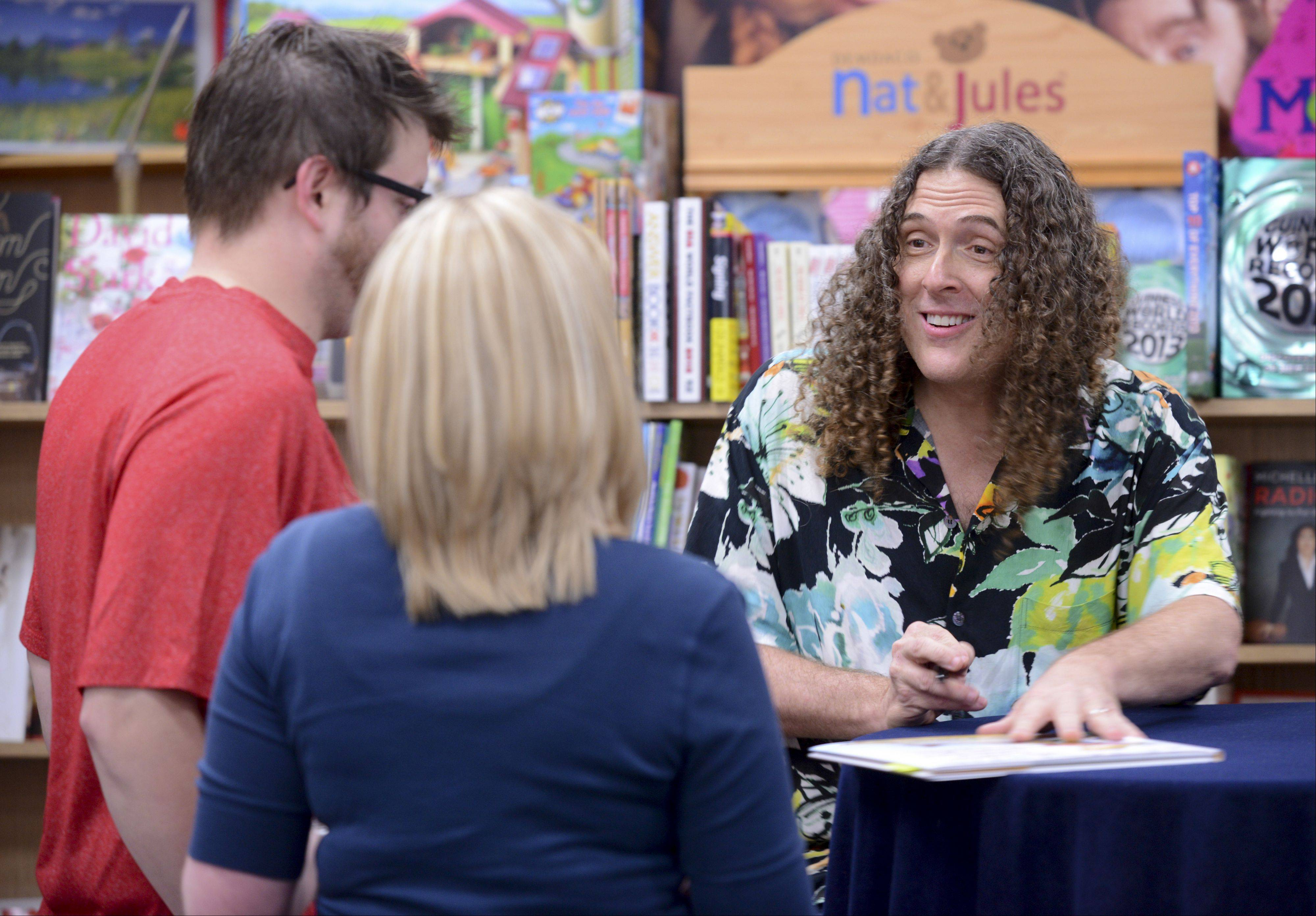"Weird Al Yankovic autographs his second children's book ""My New Teacher and Me"" on Wednesday evening at Anderson's Bookshop in downtown Naperville."