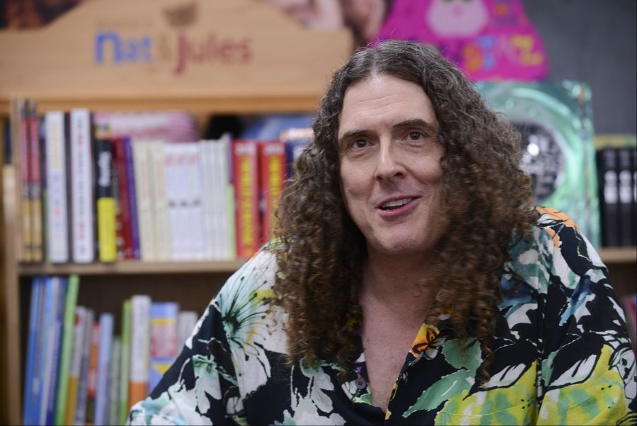 "Weird Al Yankovic signed hundreds of copies of his new children's book ""My New Teacher and Me"" on Wednesday evening at Anderson's Bookshop in downtown Naperville."