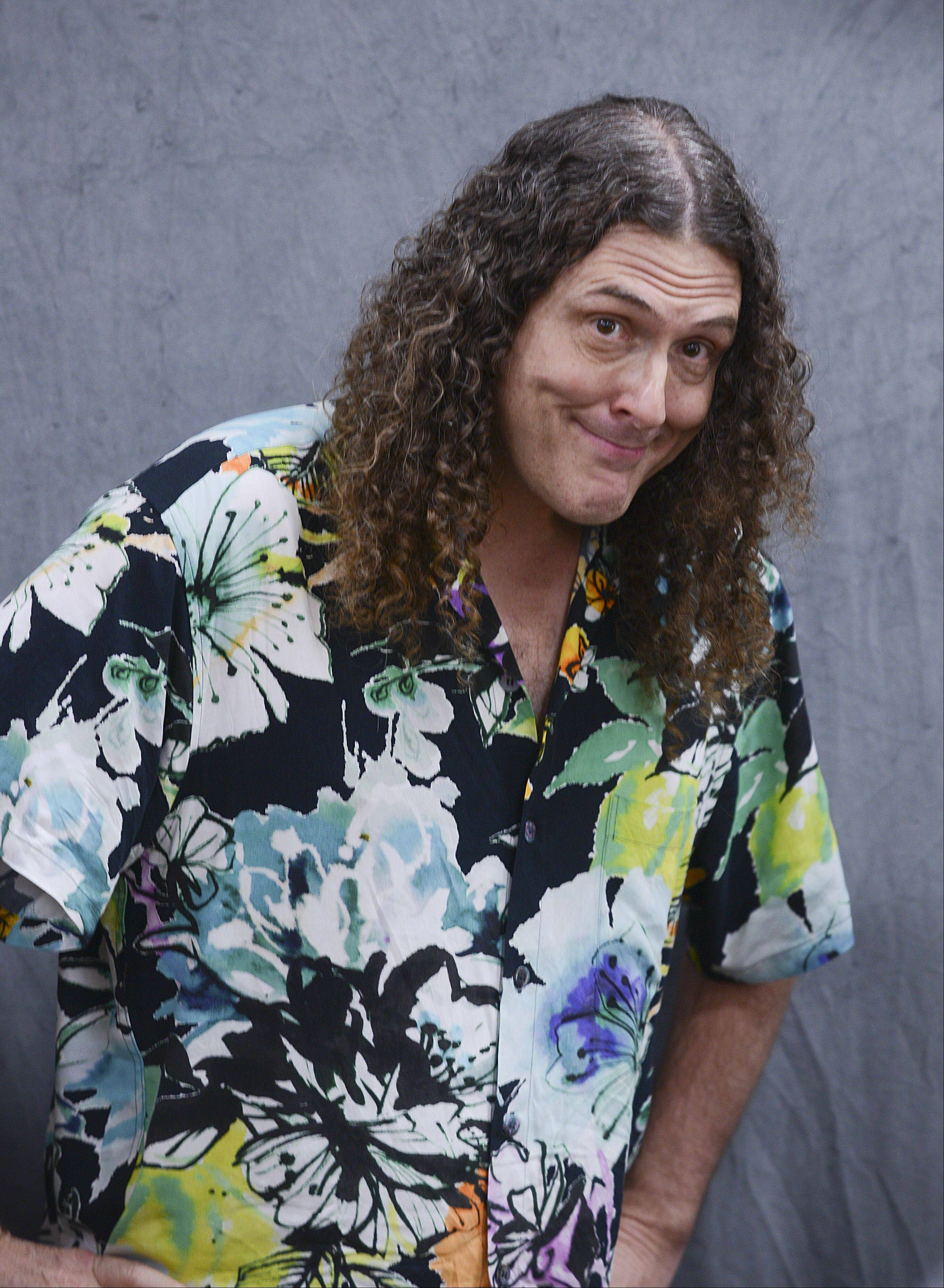 "Weird Al Yankovic promotes his second children's book, ""My New Teacher and Me,"" on Wednesday at Anderson's Bookshop in Naperville during one of seven stops on a national tour."