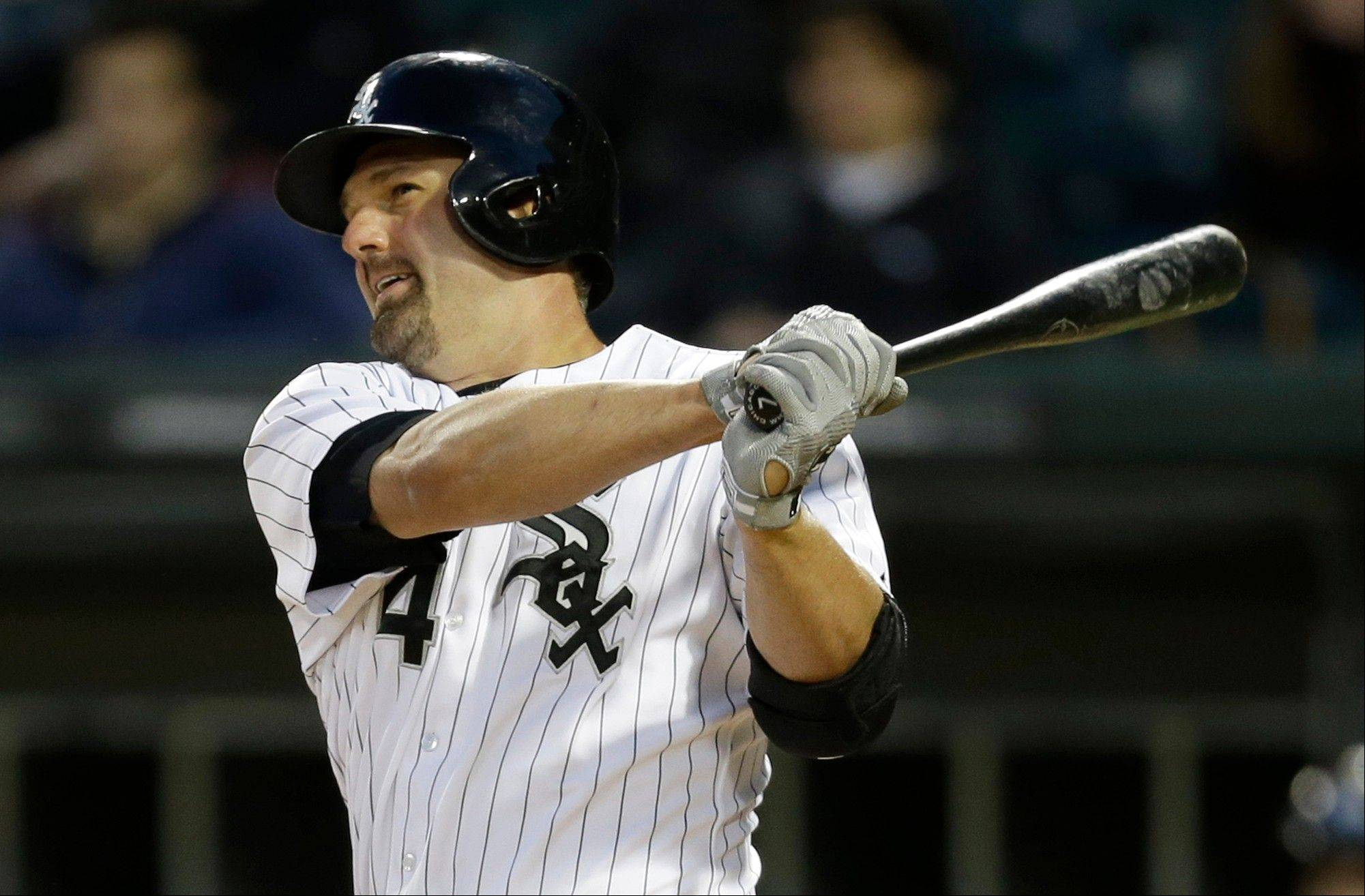 White Sox's Paul Konerko hits a single during the fifth inning of an interleague baseball game against the Miami Marlins, Friday, May 24, 2013, in Chicago.