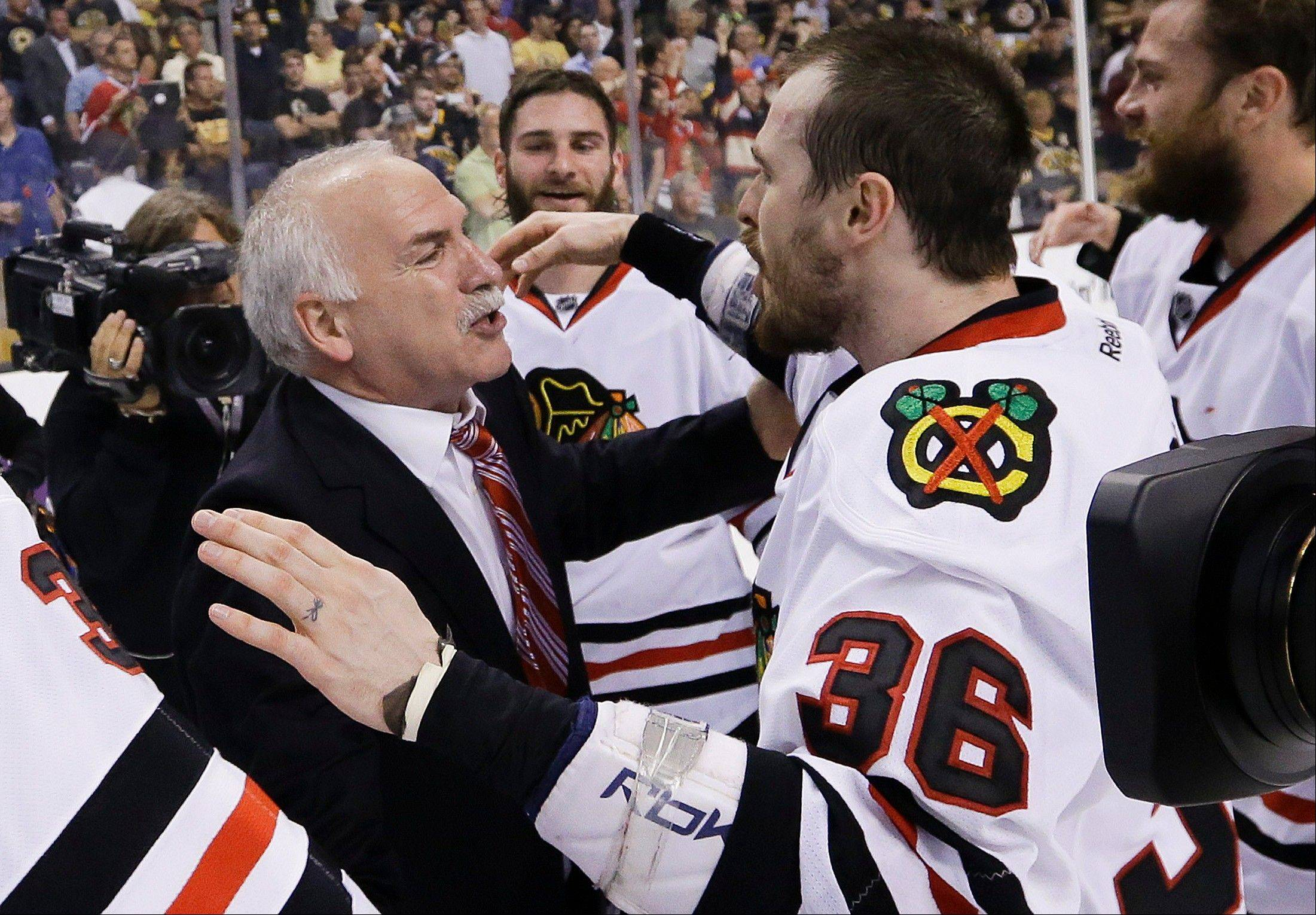 Chicago Blackhawks head coach Joel Quenneville and Chicago Blackhawks center Dave Bolland (36) celebrate the Stanley Cup championship after the Blackhawks beat the Boston Bruins 3-2in Game 6 of the NHL hockey Stanley Cup Finals Monday, June 24, 2013, in Boston. (AP Photo/Elise Amendola)