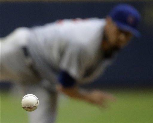 Matt Garza struck out 10 in seven solid innings and Dioner Navarro hit a three-run homer, sending the Cubs to a 7-2 victory over the Milwaukee Brewers on Thursday. Garza (3-1) had his third consecutive strong outing. The right-hander allowed one run on eight hits and a walk while throwing 101 pitches.