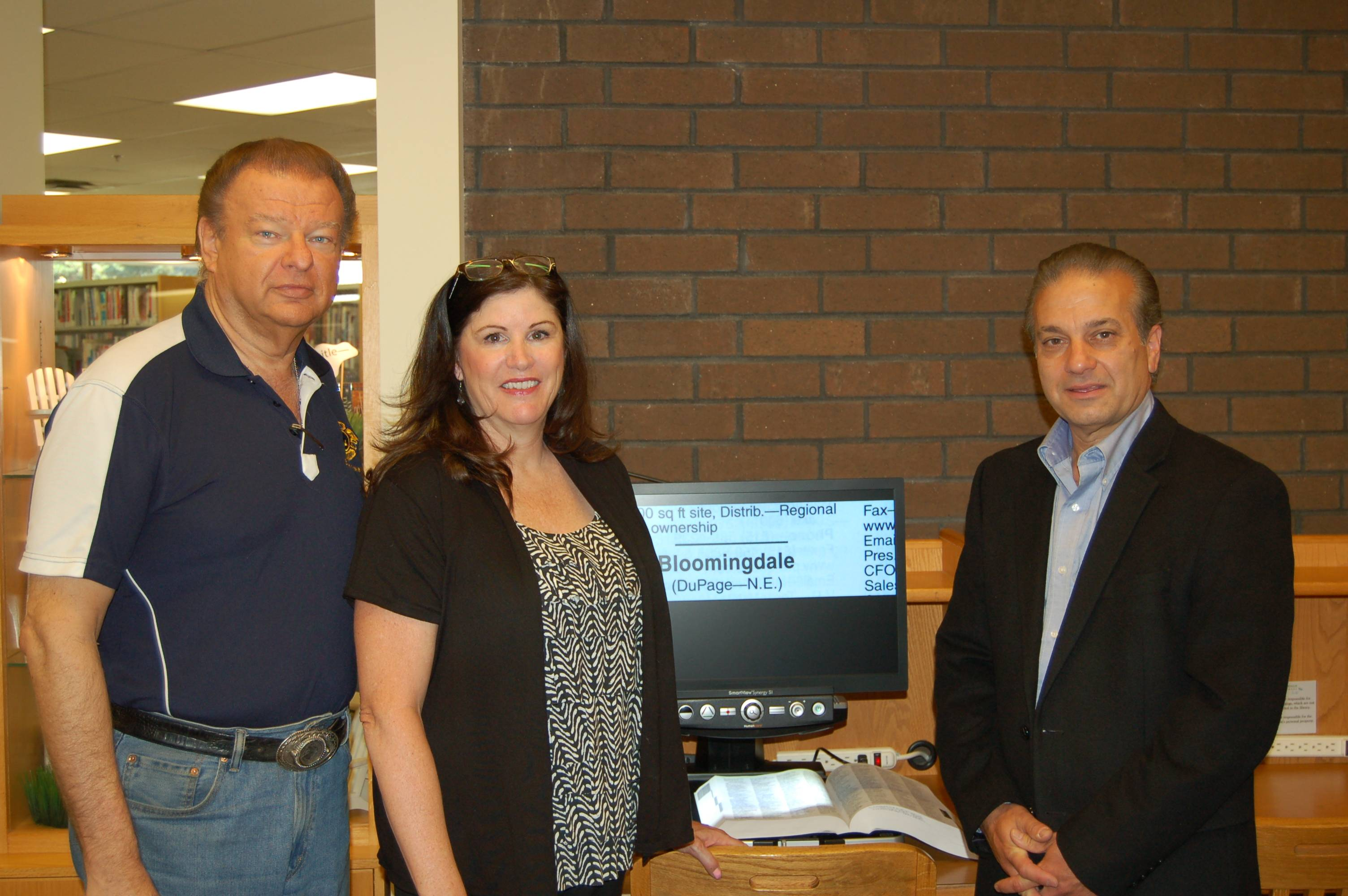From left:  Stan Poplonski, President of the Bloomingdale Lions Club; Julie Keating, Bloomingdale Public Library Adult Services Department Head; and Sam D'Amico, President of the Bloomingdale Public Library Friends of the Library.