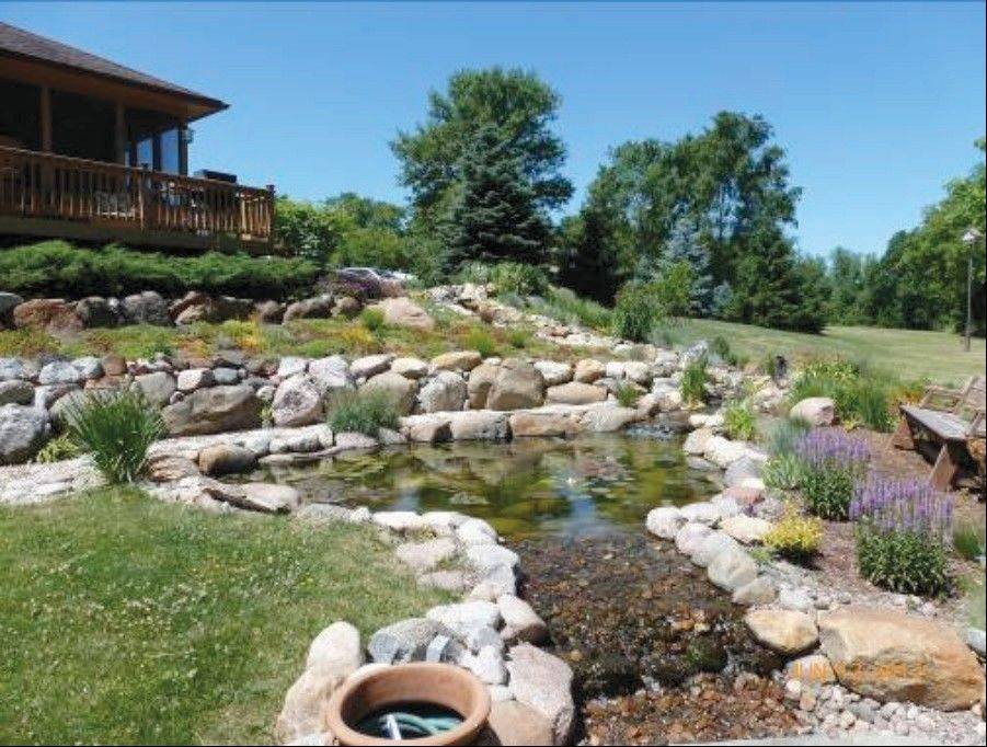 Most visitors will first notice the koi pond and waterfall garden as they enter this Spring Grove landscape during the July 13 garden walk. It also features 15 garden beds, a half-acre native prairie, a bird and butterfly garden, a shade garden and two rock gardens.