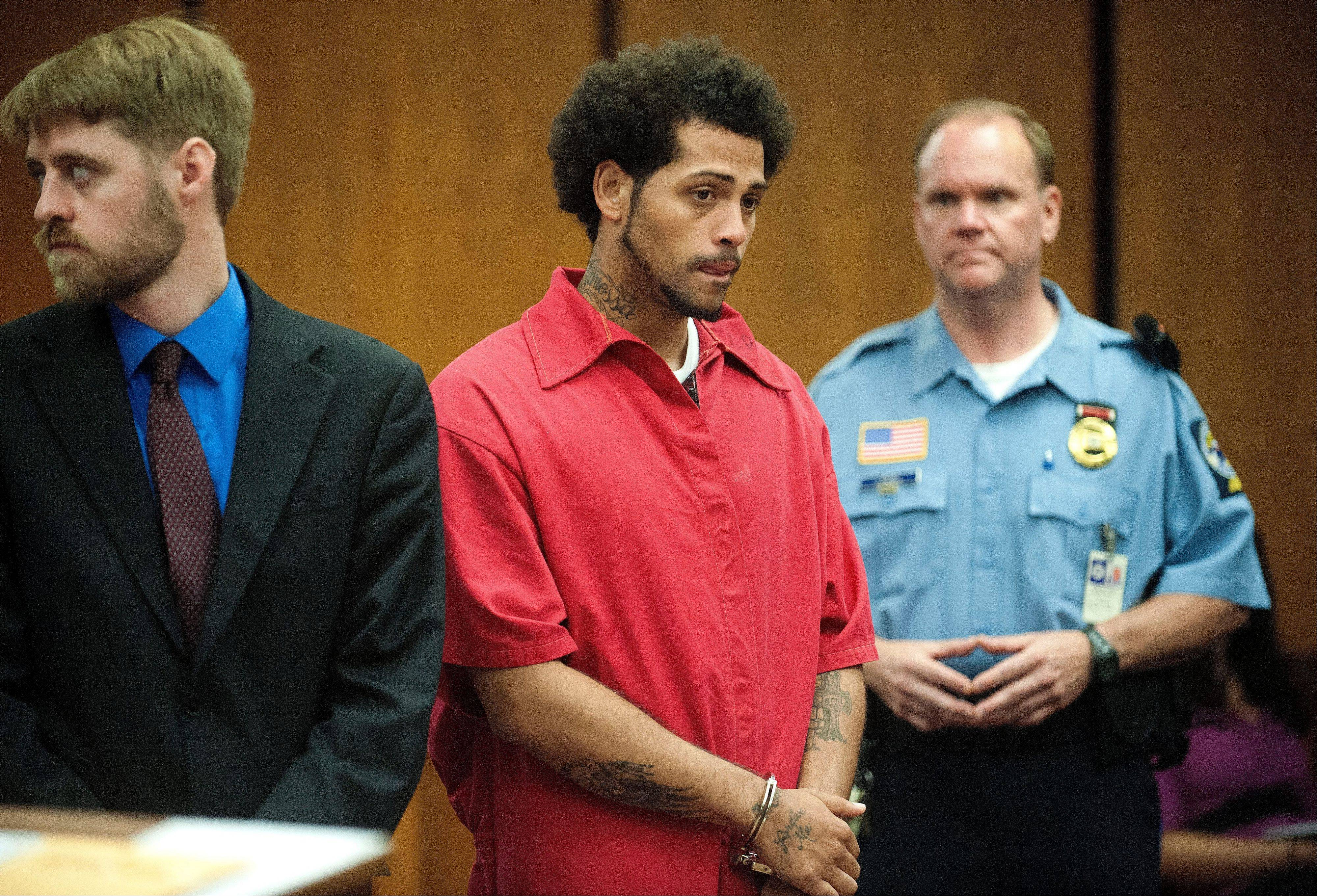 Carlos Ortiz, center, faces the court during a hearing Friday in Bristol, Conn.