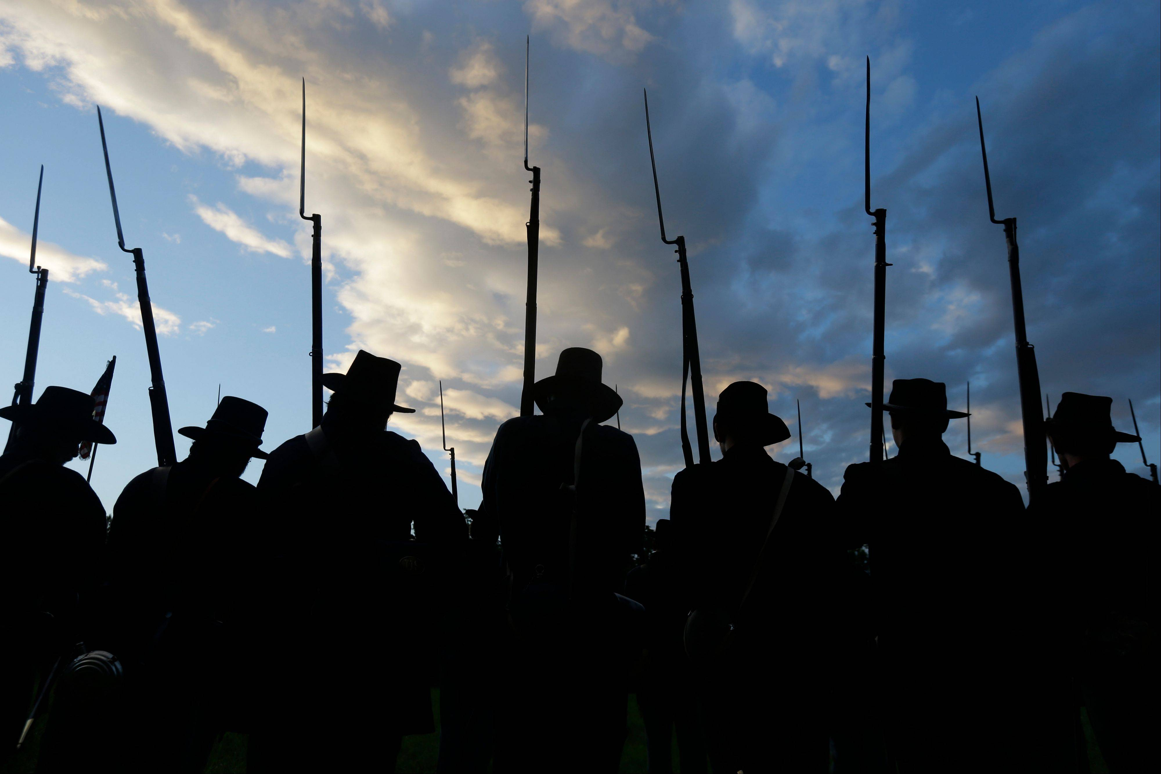 Re-enactors portraying Union soldiers in the Murray's Brigade drill Thursday during ongoing activities commemorating the 150th anniversary of the Battle of Gettysburg.