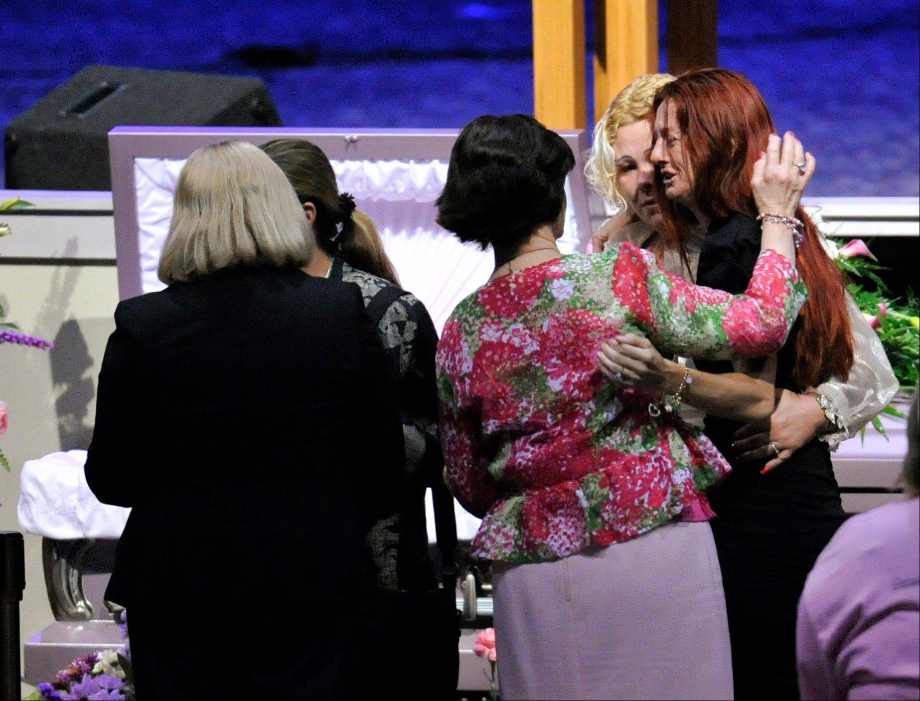 Rayne Perrywinkle, right, is consoled at the casket of her daughter, 8-year-old Cherish Perrywinkle, at Paxon Revival Center Church on Thursday, June 27, 2013 in Jacksonville, Fla. Cherish, who police say was targeted by a registered sex offender, was abducted and killed last Friday.