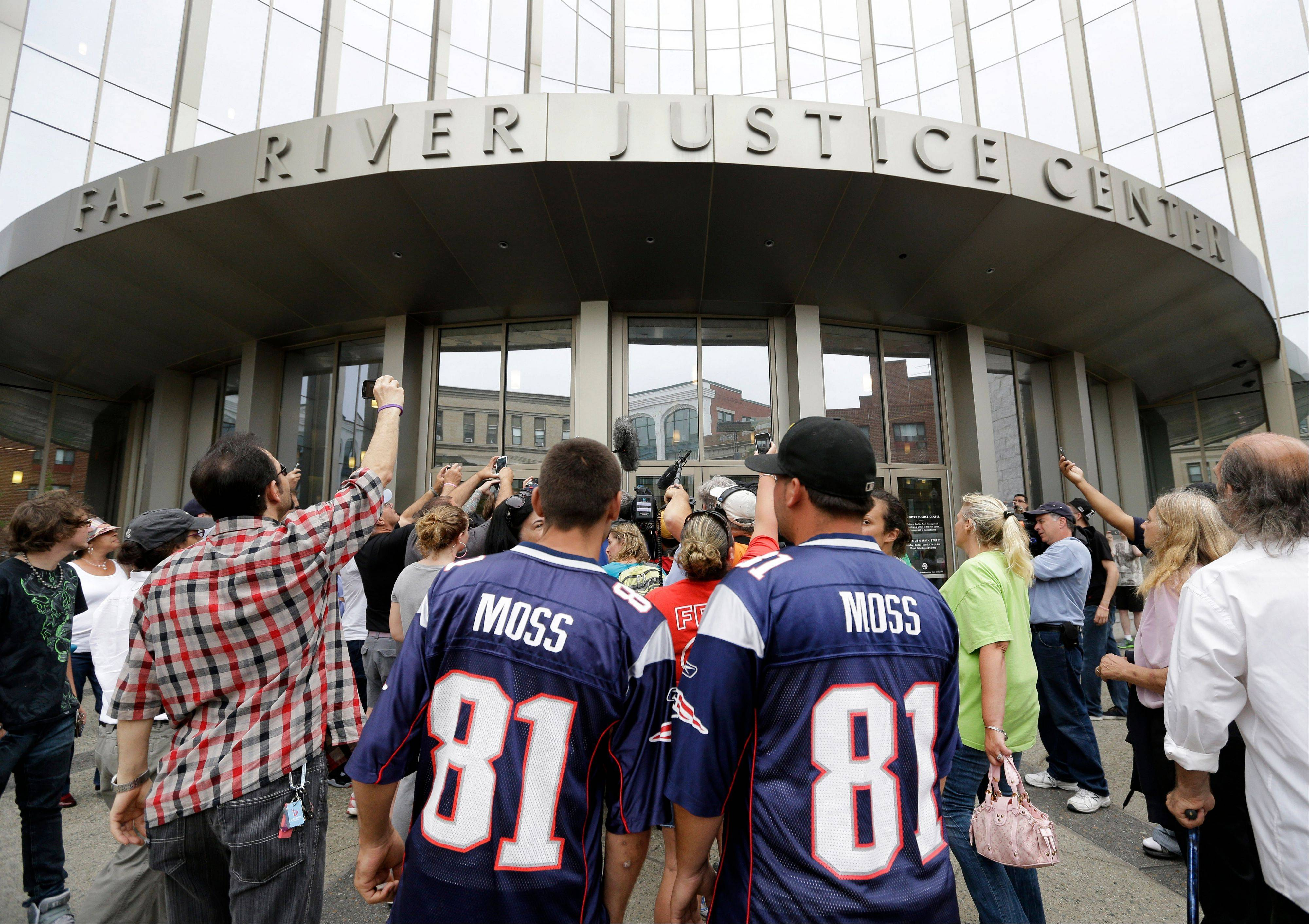 Interested bystanders and media members crowd around the entrance to the Fall River Justice Center after a bail hearing was held for former New England Patriots football player Aaron Hernandez in Fall River Superior Court Thursday, June 27, 2013 in Fall River, Mass. Hernandez, charged with murdering Odin Lloyd, a 27-year-old semipro football player, was denied bail.