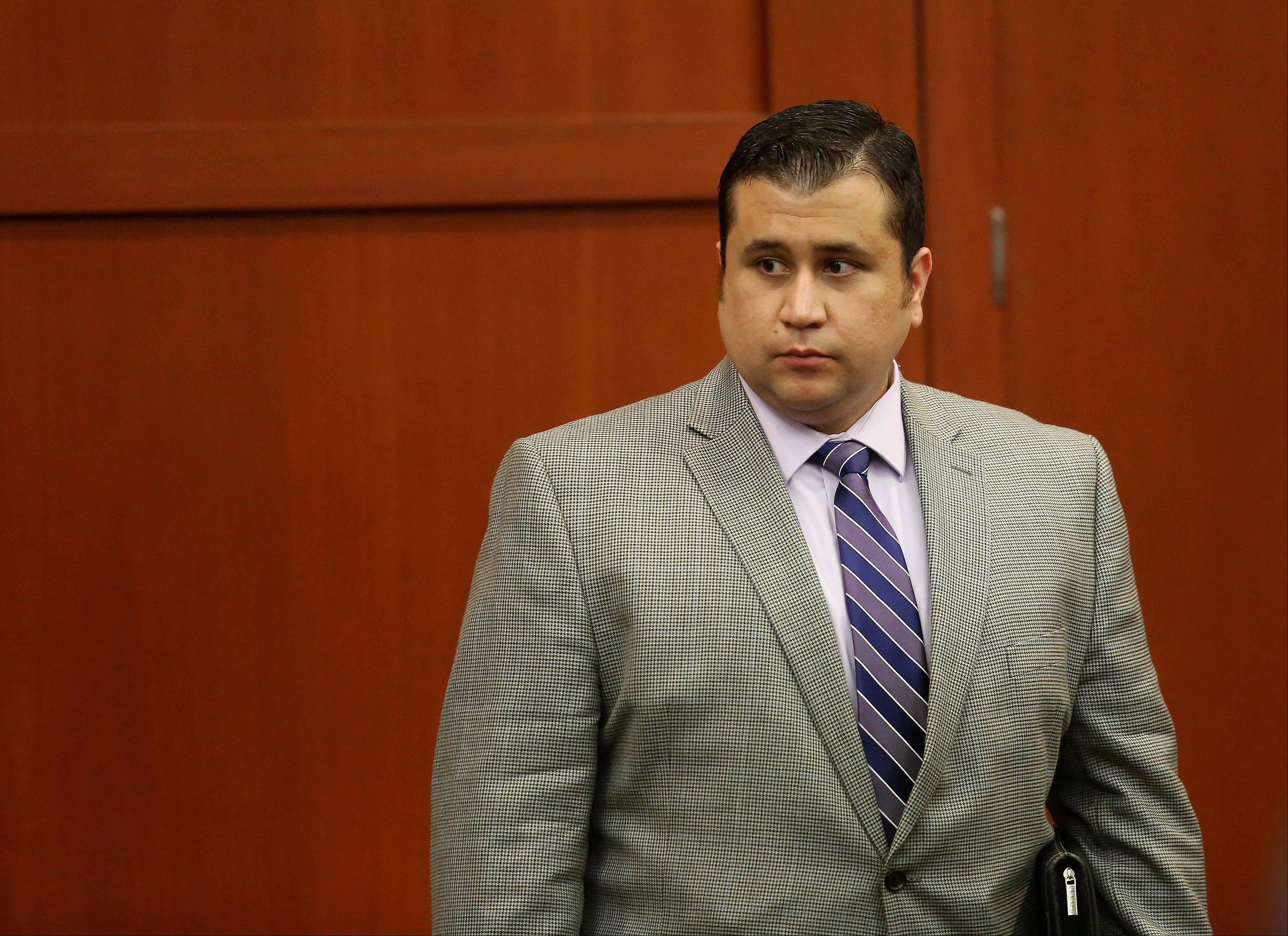 George Zimmerman leaves the courtroom for the day in his trial in Seminole circuit court in Sanford, Fla. on Thursday, June 27, 2013. Zimmerman has been charged with second-degree murder for the 2012 shooting death of Trayvon Martin.