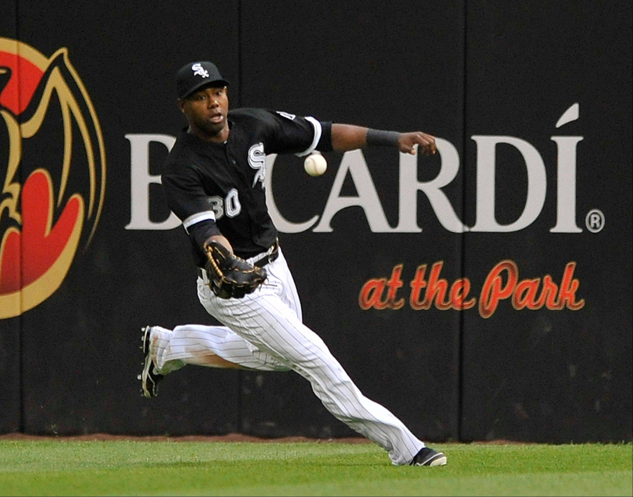 White Sox center fielder Alejandro De Aza chases down a double hit by Cleveland Indians' Jason Kipnis during the eighth inning of the first game of a doubleheader baseball game in Chicago, Friday, June 28, 2013. Cleveland won 19-10.