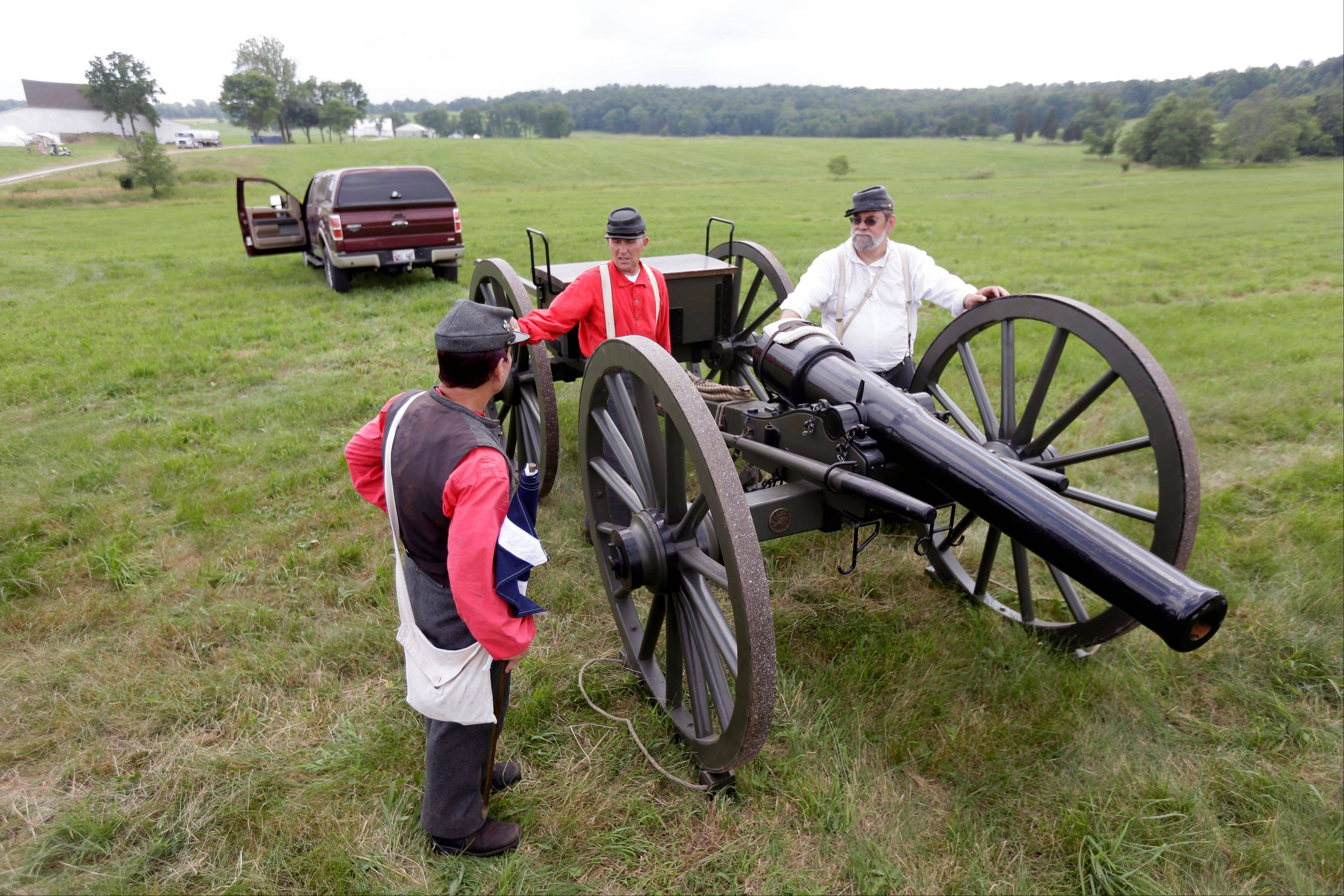 Members of the 4th Maryland Light Artillery unload their weapon in the Artillery park during ongoing activities commemorating the 150th anniversary of the Battle of Gettysburg on Thursday.