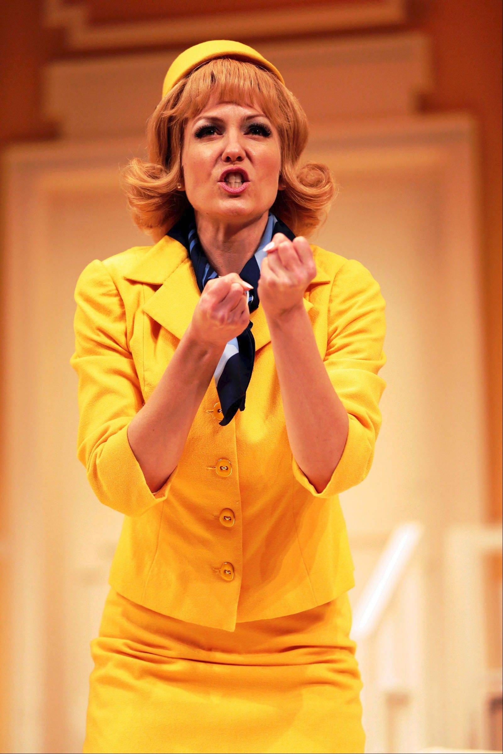 "Katherine Keberlein plays German flight attendant Gretchen in Drury Lane Theatre's revival of the French comedy ""Boeing-Boeing,"" directed by Dennis Zacek."