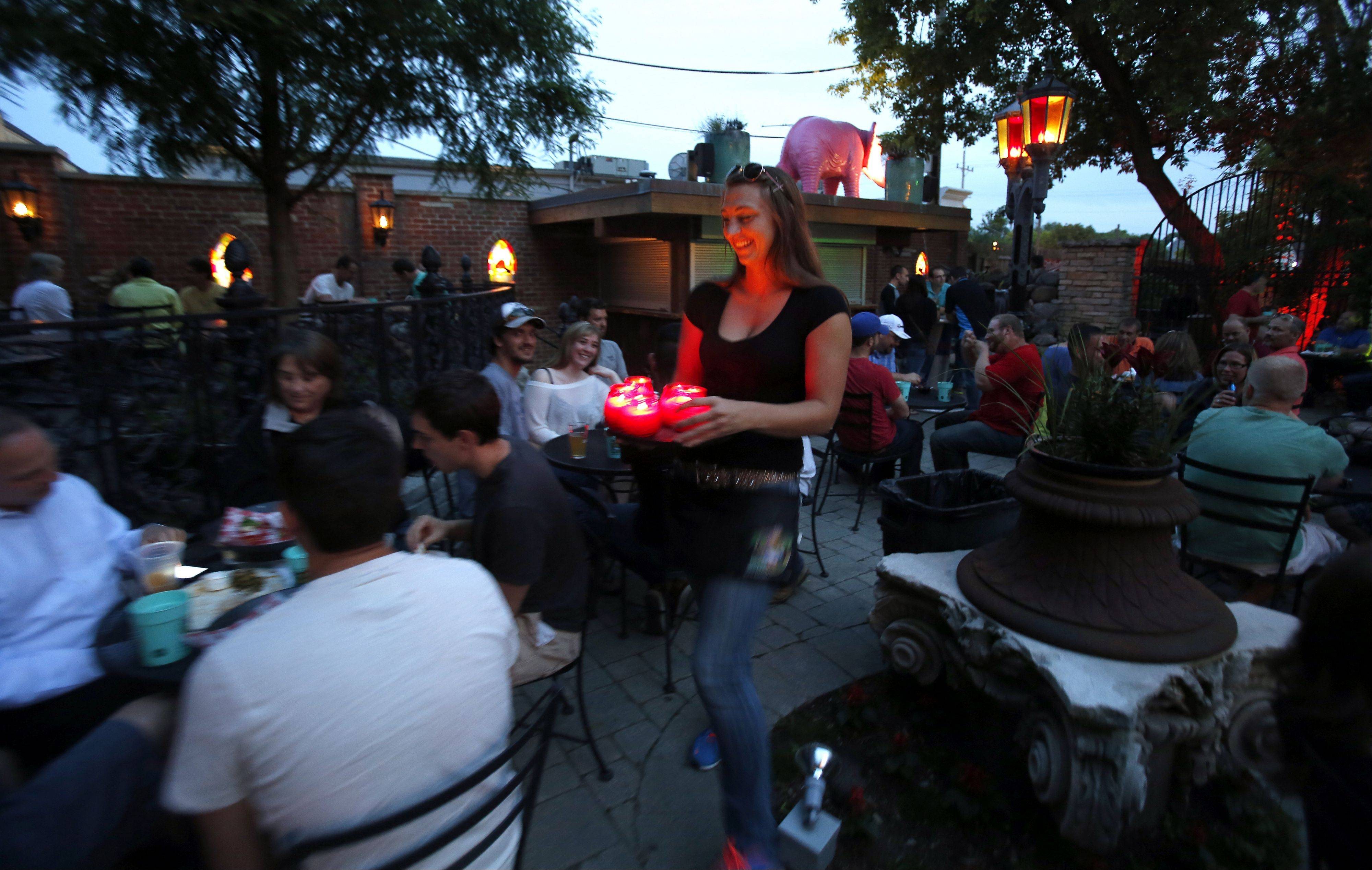 Gaby Moe makes the rounds on the outdoor deck at Bandito Barney's in East Dundee.