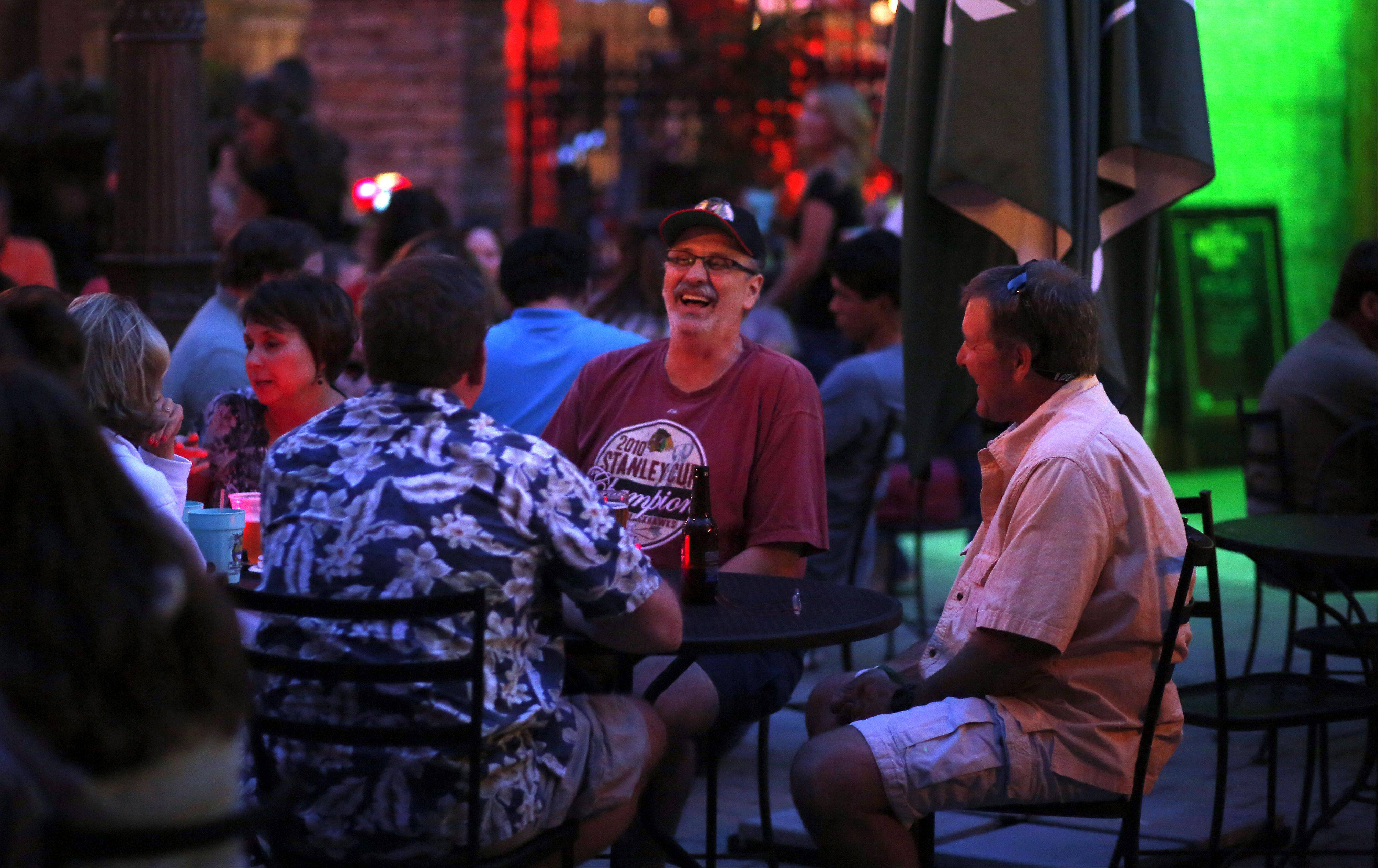 Gary Radaszewski, center, shares a laugh with Jim Lauber, right, on the outdoor deck at Bandito Barney's in East Dundee.
