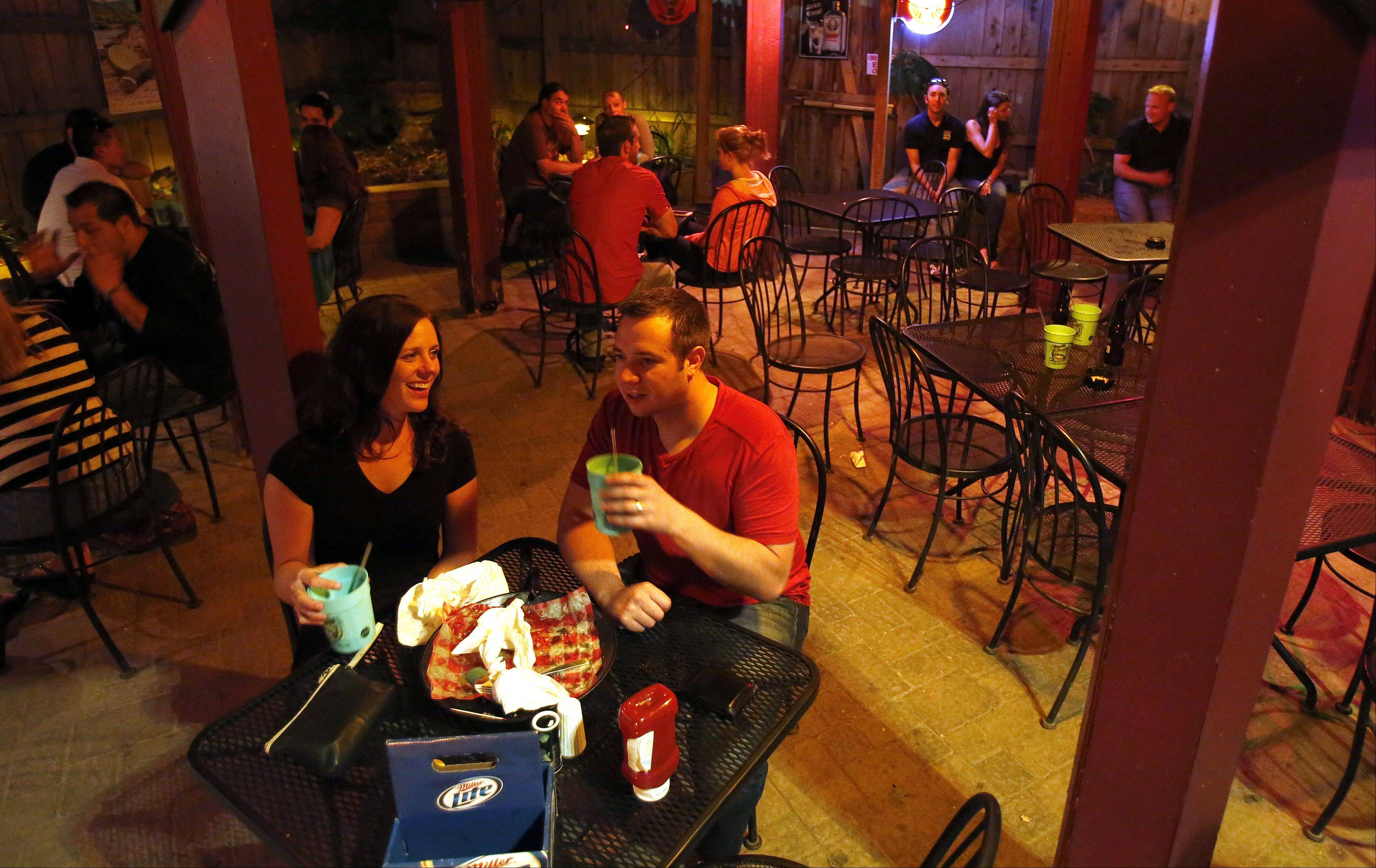 Megan and Chris Roney of Gilberts enjoy a drink outdoors at Bandito Barney's in East Dundee.