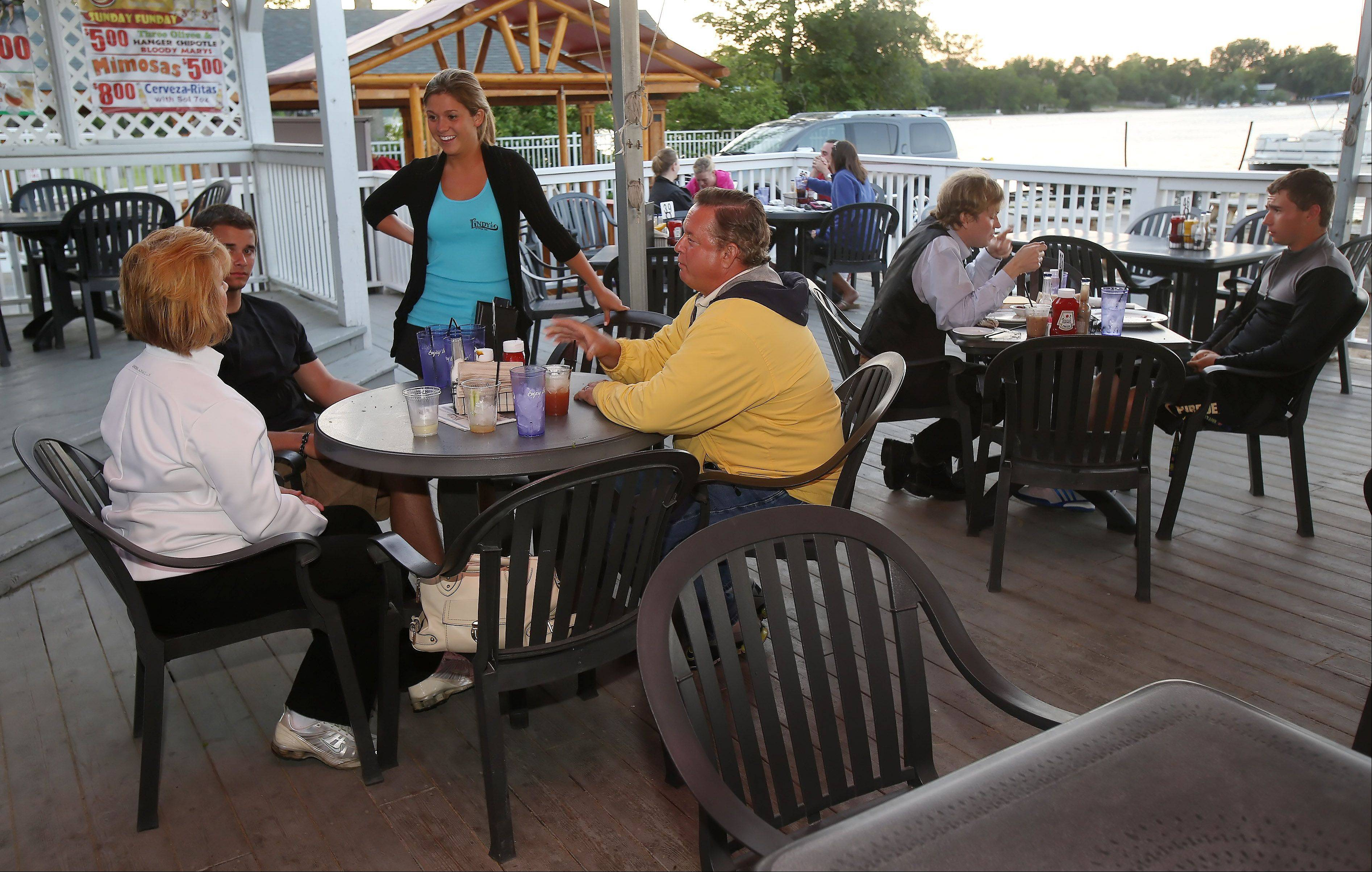 Waitress Gaby Luurs talks to customers on the outer bar deck at Lindy's Landing in Wauconda.