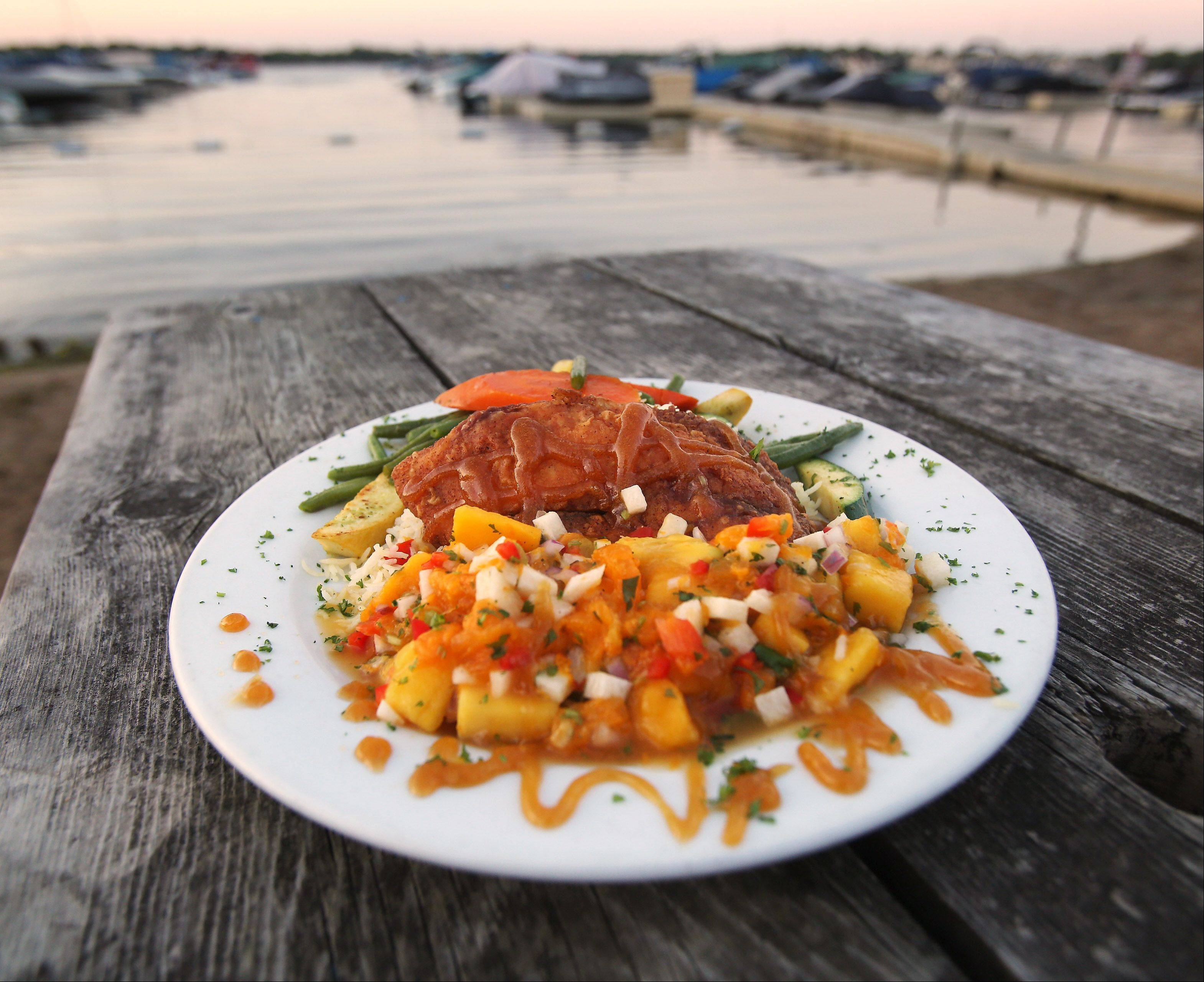 Enjoy summertime tilapia topped with mango salsa while taking in the view at Lindy's Landing in Wauconda.