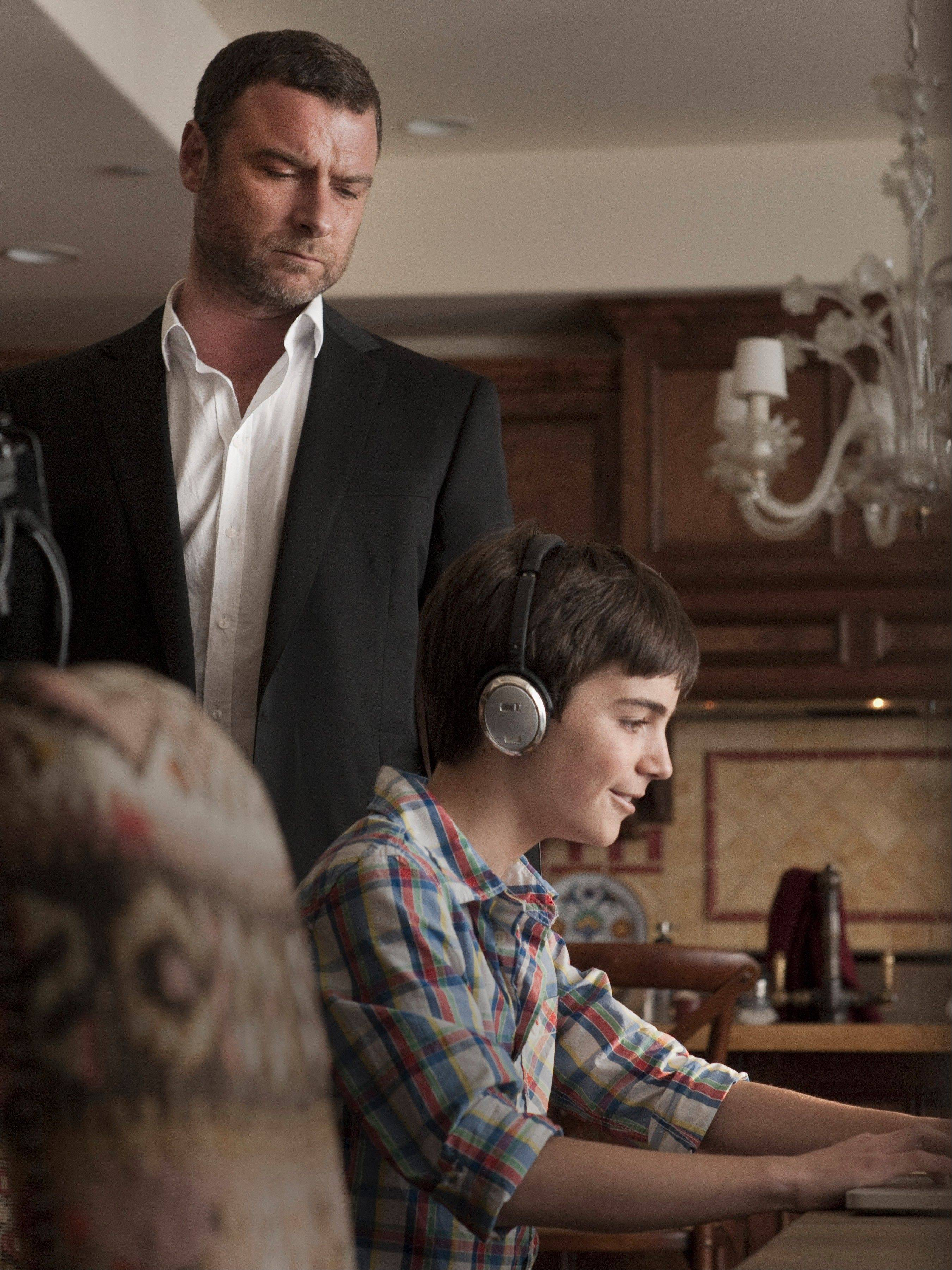 "A devoted dad (Liev Schreiber), left, must protect his family, including his son (Devon Bagby), when his gangster father is released from prison in Showtime's ""Ray Donovan."""
