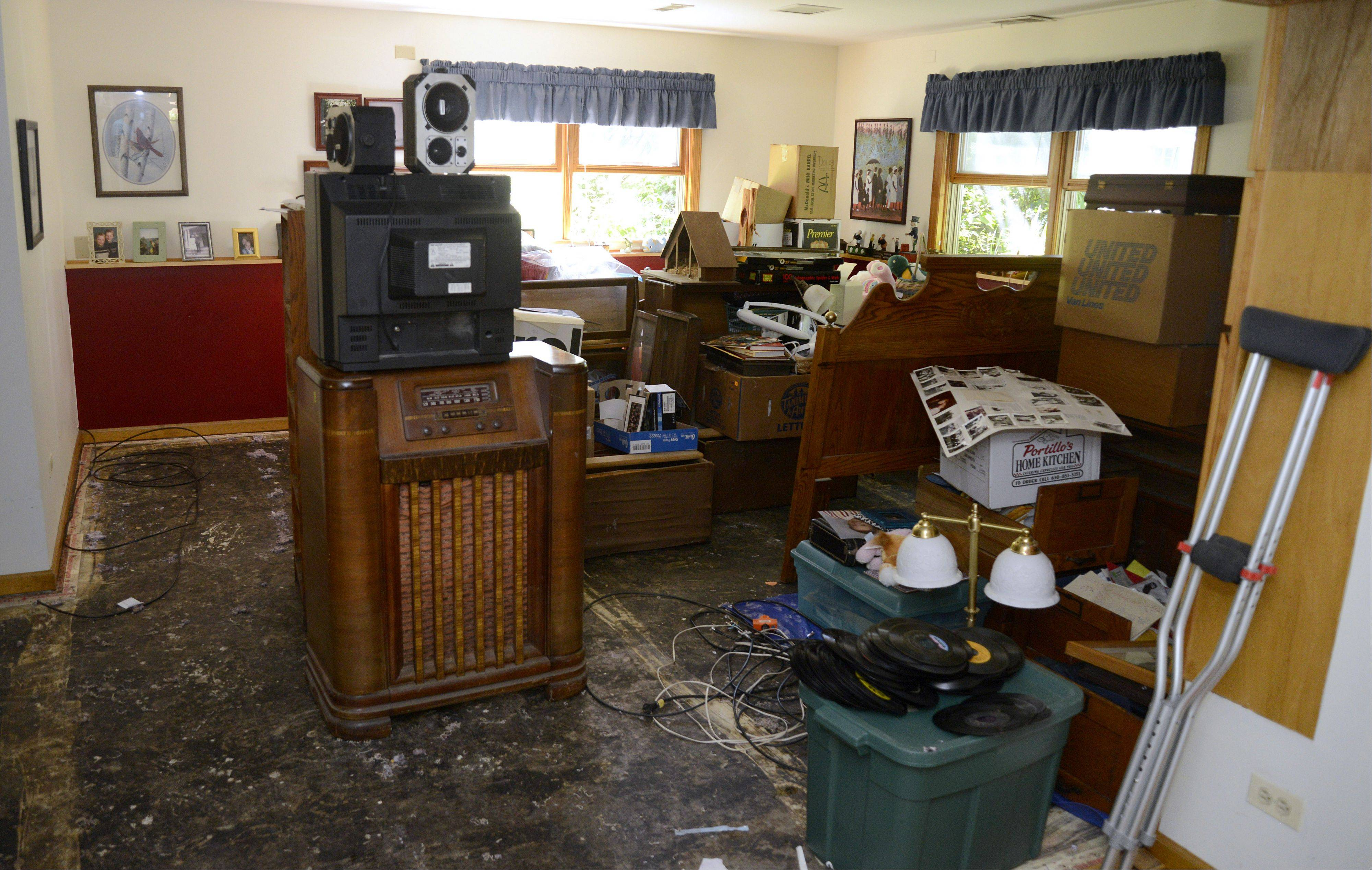 These items inside the Cary home of Kathi and Steven Riley show the extent of flood damage that left sewer water in their basement. The couple, married for 33 years, lost their wedding photos and some of the antiques Steven collects.
