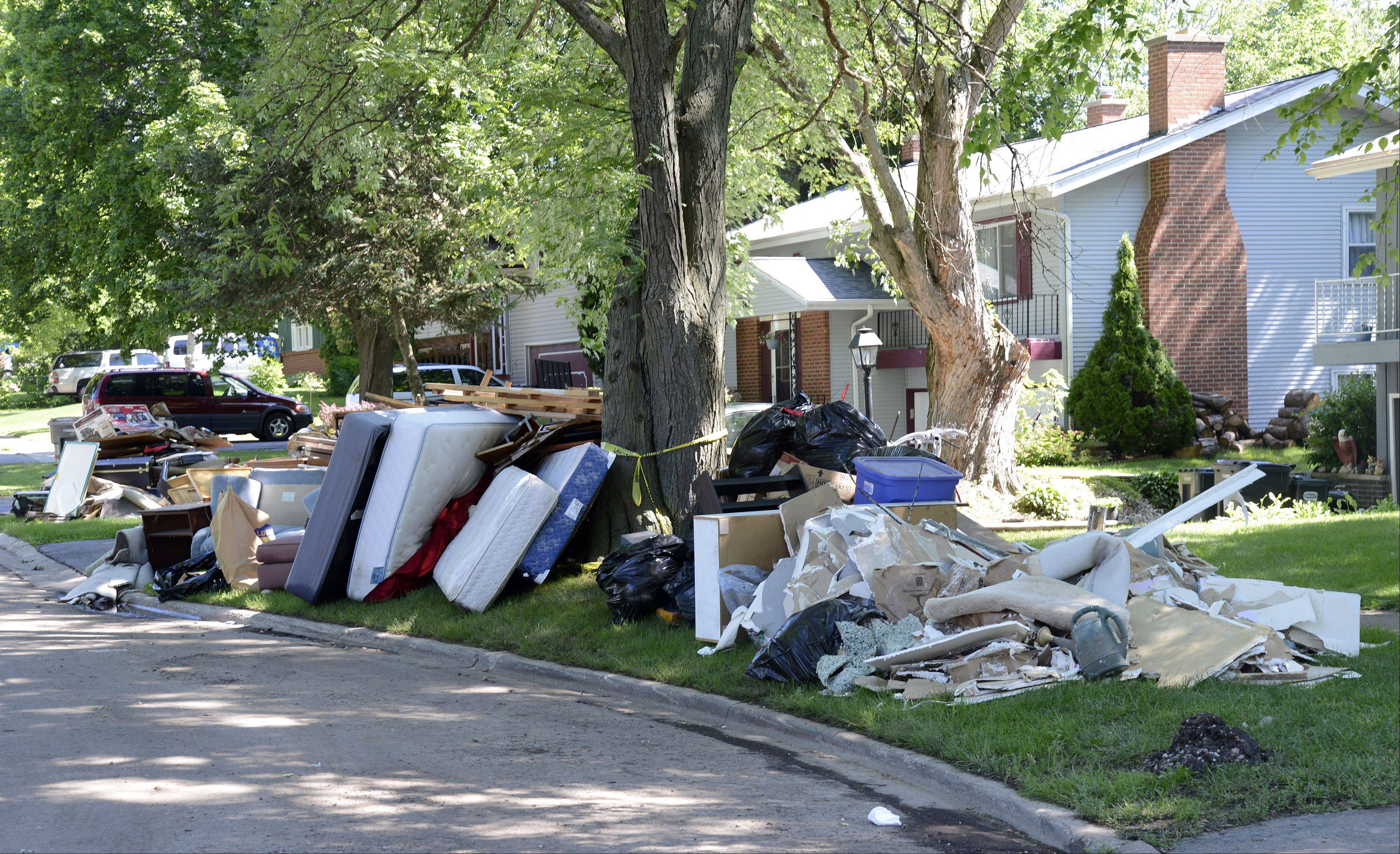 Damaged items from the homes line Crest Drive in Cary. The village arranged a special trash pickup at no charge to the residents Friday and are holding a special meeting for the Sunset/Crest residents July 11 to help them secure money for their damaged property.