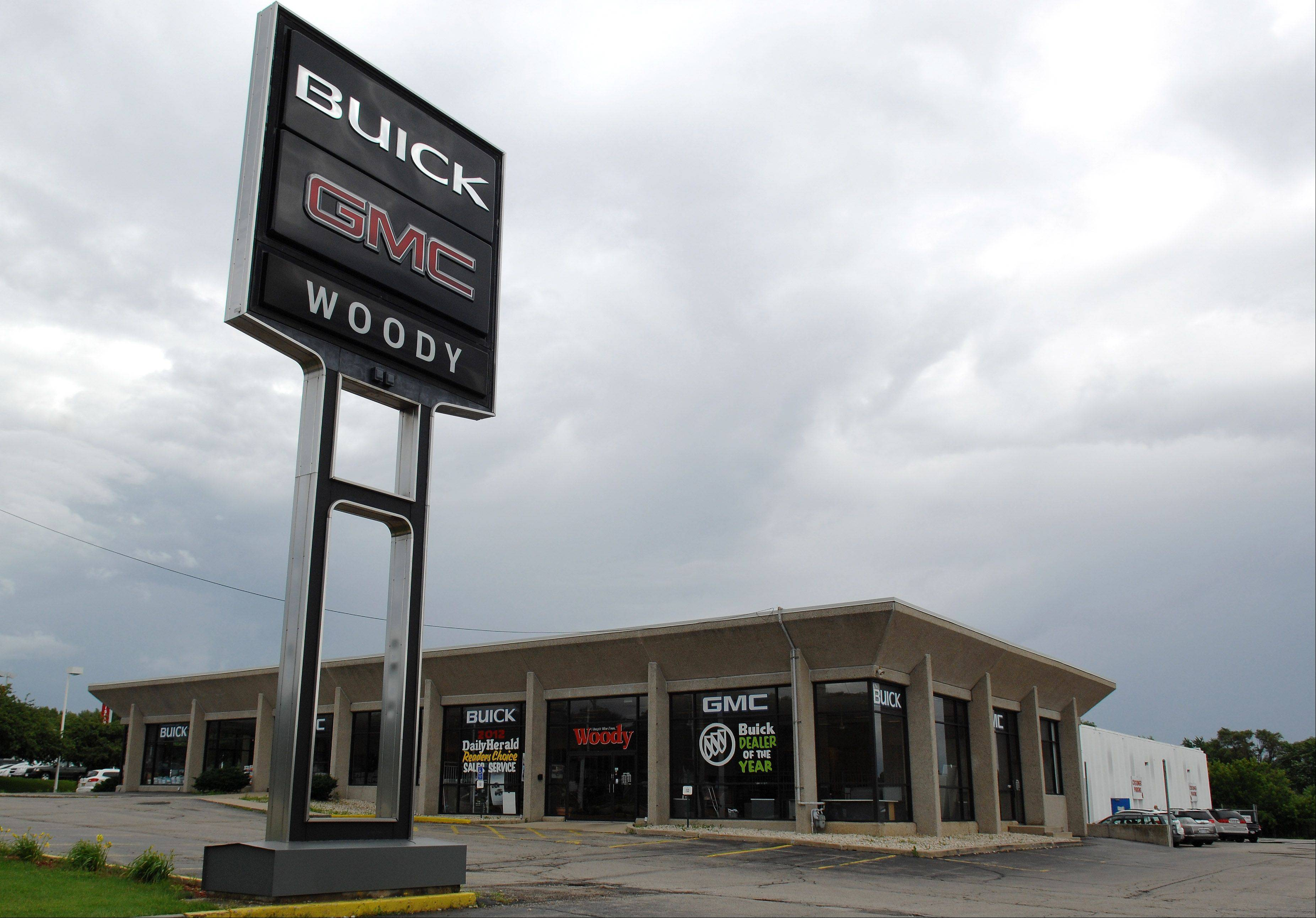 Woody Buick in Elgin is closing, with its owner saying he could not afford the $1.5 million building upgrade demanded by GMC.