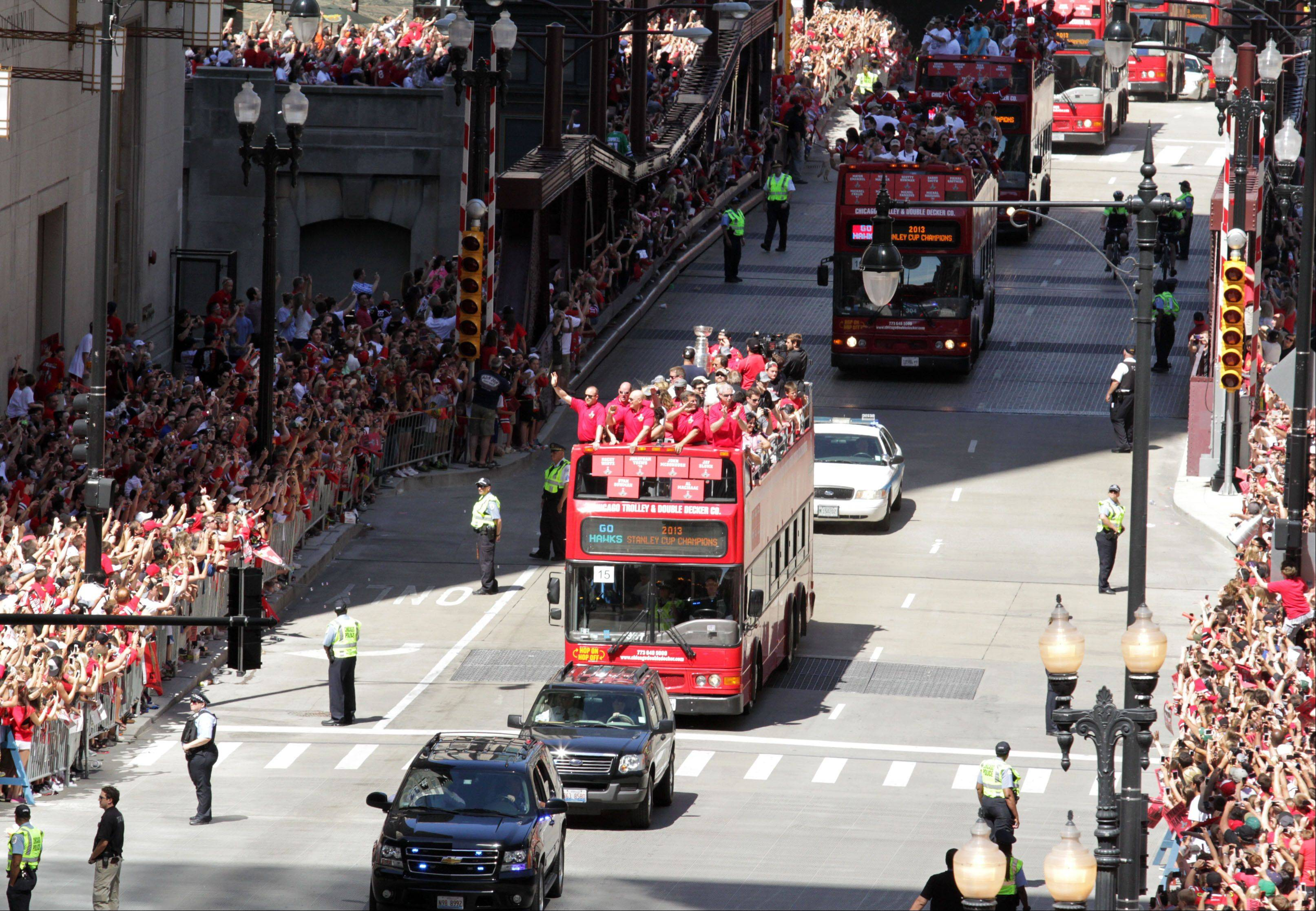 The Blackhawks Stanley Cup parade travels east on Washington Street to Michigan Avenue in Chicago on Friday.