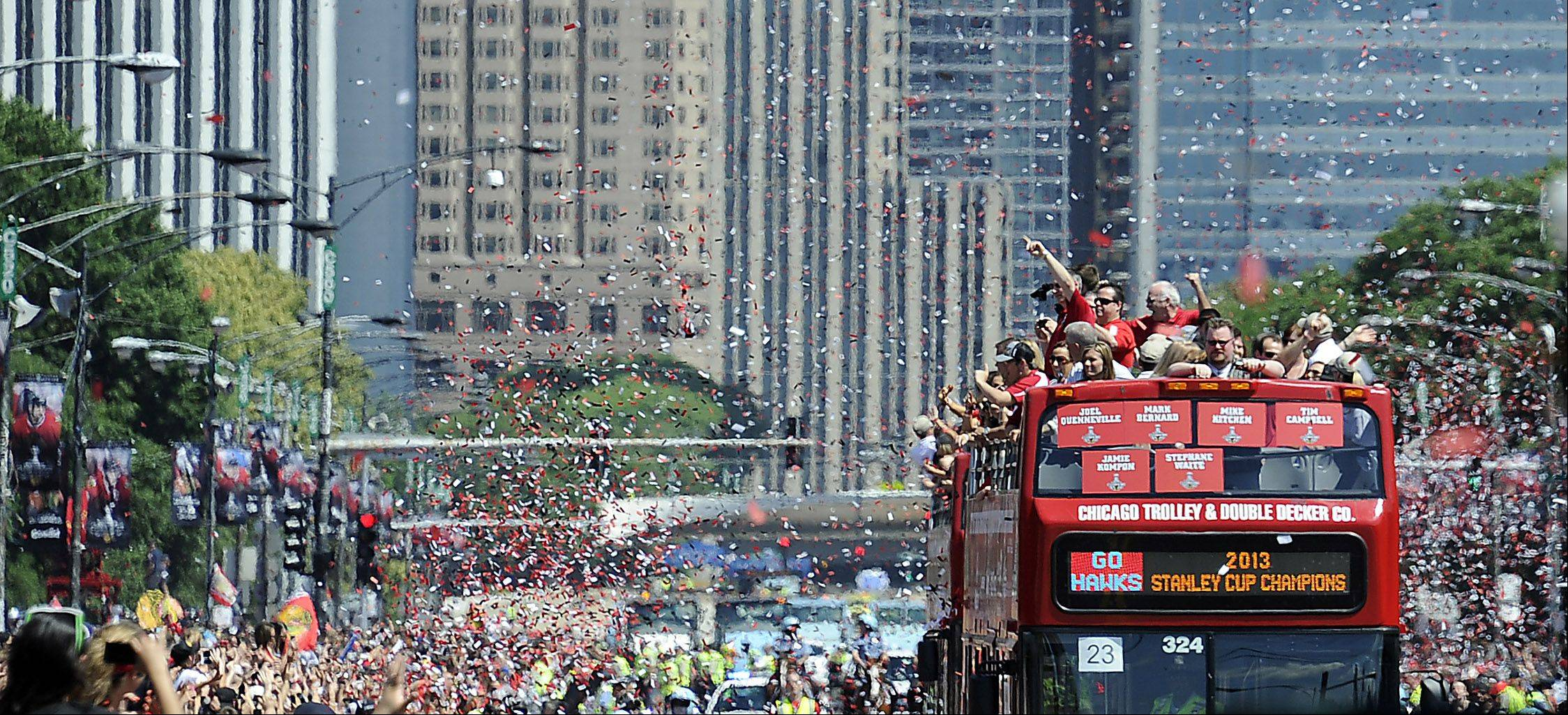 Chicago Blackhawks coaches bus along the parade route heading to Grant Park.