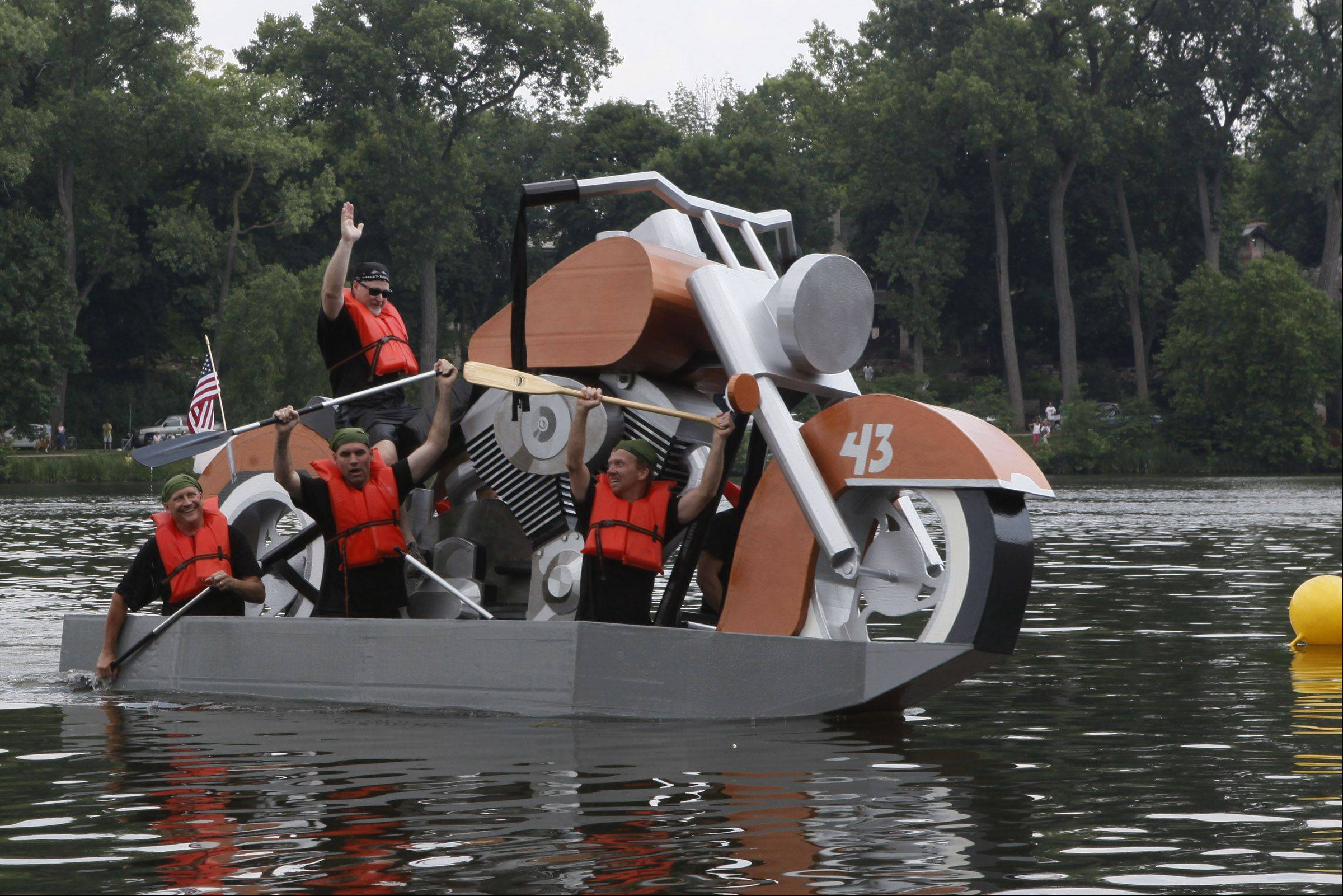 Jim Craig, atop the motorcycle seat, and his crew have come up with some creative design ideas in past years for Lake Ellyn's Cardboard Regatta in Glen Ellyn, including in 2011 when they built a replica Harley-Davidson motorcycle.