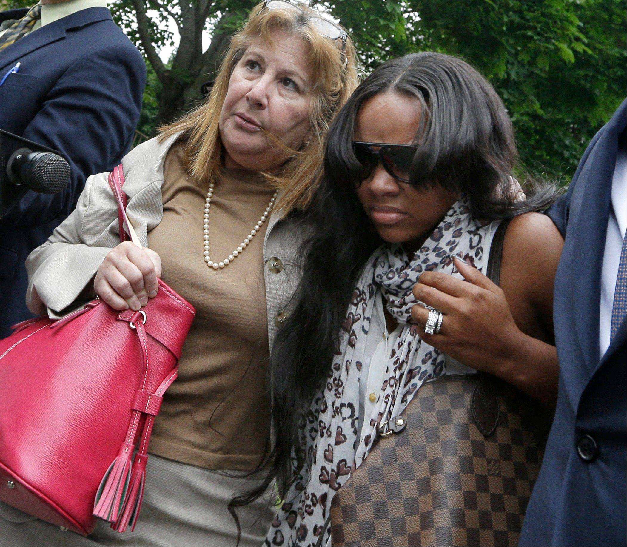 Shayanna Jenkins, right, fiancee of former New England Patriots football player Aaron Hernandez, is escorted by attorney Janice Bassil after a bail hearing in Fall River Superior Court Thursday, June 27, 2013 in Fall River, Mass. Hernandez, charged with murdering Odin Lloyd, a 27-year-old semipro football player, was denied bail.