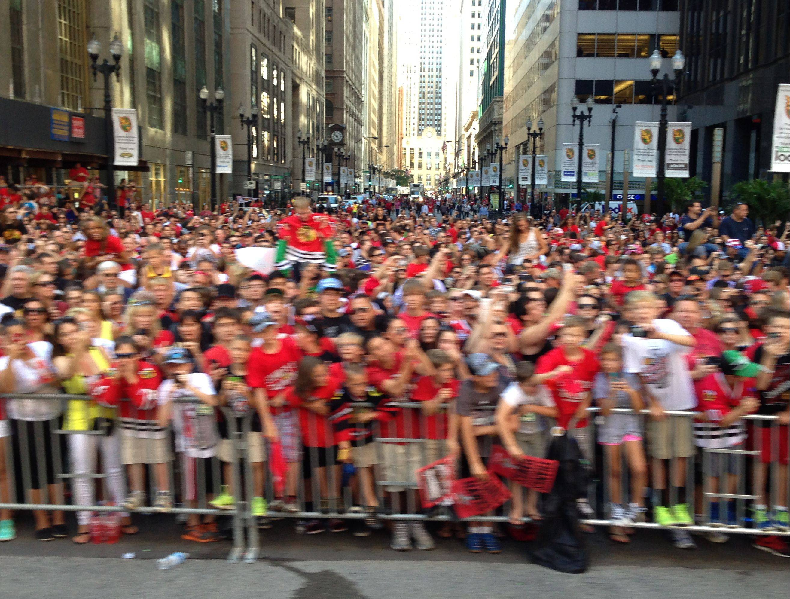 Fans along the Blackhawks parade route Friday morning as the buses head to Grant Park.