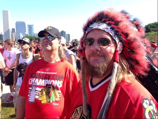 Andy Haas of Oswego, right, and Mike Vitacco of Westmont wait for the Blackhawks rally at Grant Park Friday morning.