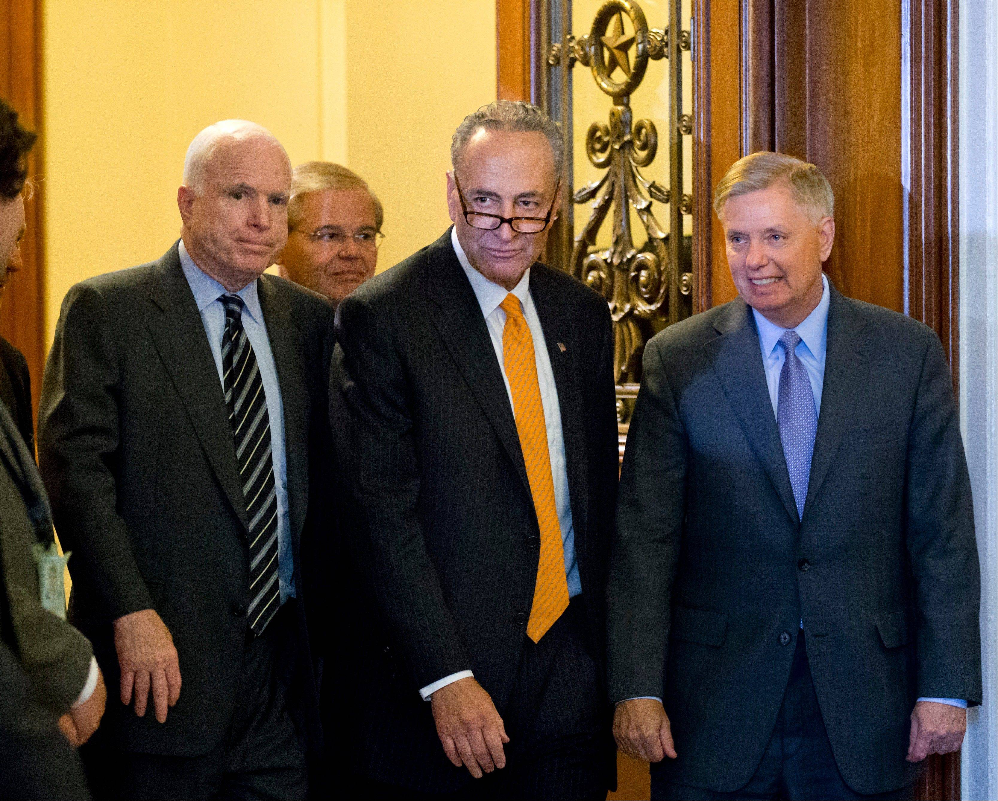 "Members of the bipartisan ""Gang of Eight"" who crafted the immigration reform bill, Sen. Chuck Schumer, D-N.Y., center, flanked by Sen. John McCain, R-Ariz., left, and Sen. Lindsey Graham, R-S.C., leave the floor after final passage in the Senate, at the Capitol in Washington, Thursday, June 27, 2013. Sen. Robert Menendez, D-N.J., follows at rear. In remarks to reporters, Sen. Lindsey Graham, a conservative Republican, praised the leadership of Democrat Chuck Schumer, saying ""Senator Schumer's a worthy successor to Ted Kennedy."""