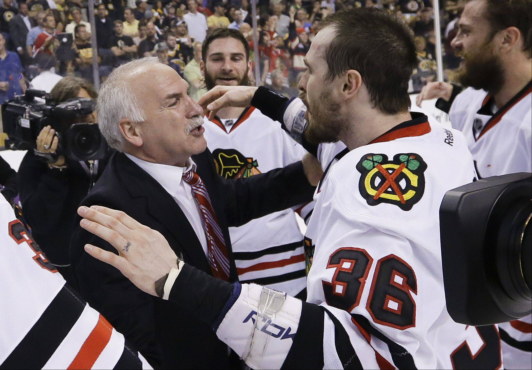 Blackhawks head coach Joel Quenneville, here congratulating center Dave Bolland after winning the Stanley Cup in Boston, deserves a lot of credit for the title run.