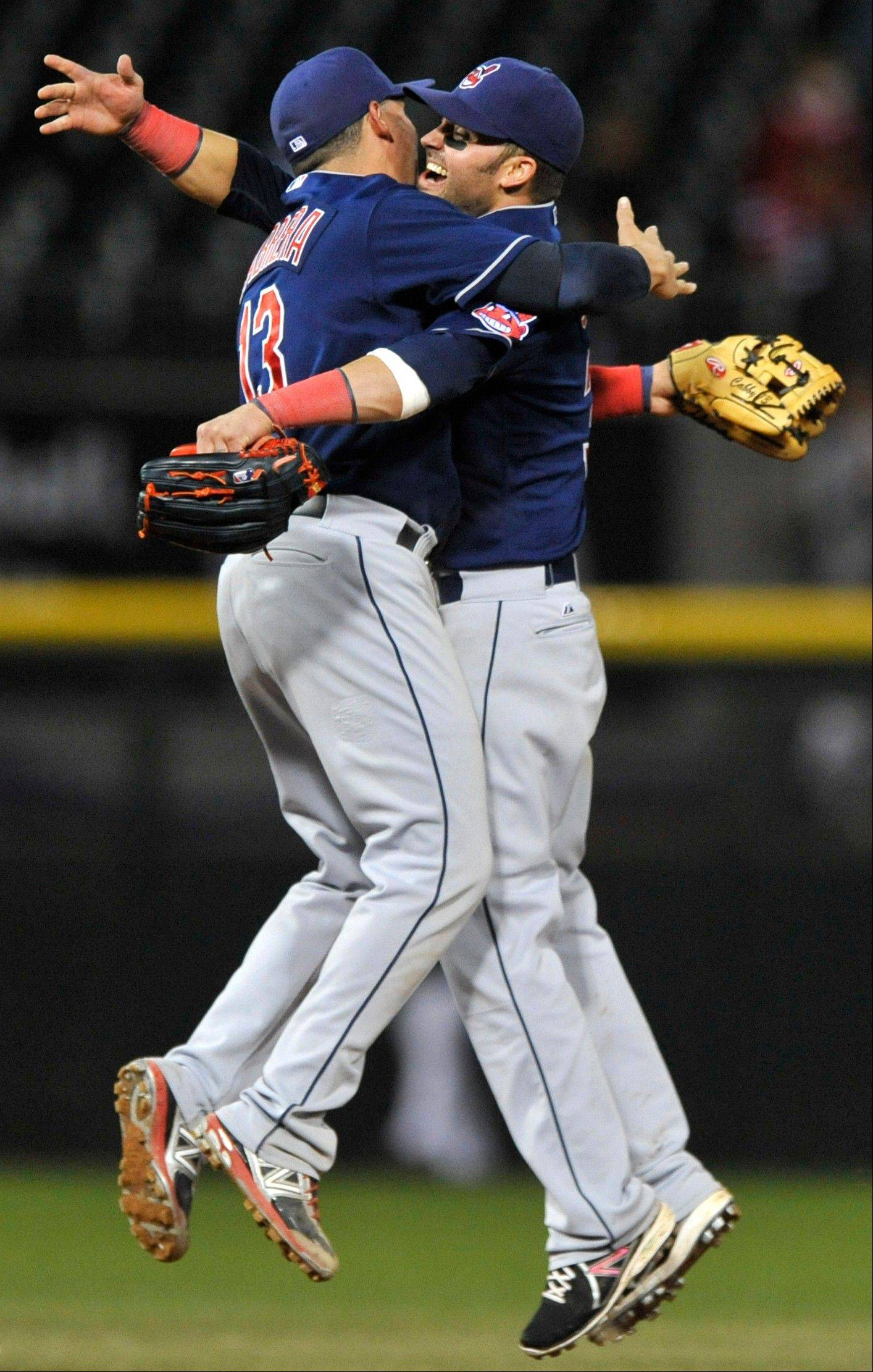 Cleveland's Nick Swisher, right, and Asdrubal Cabrera celebrate after defeating the Chicago White Sox 9-8 in the second game of a doubleheader in Chicago.